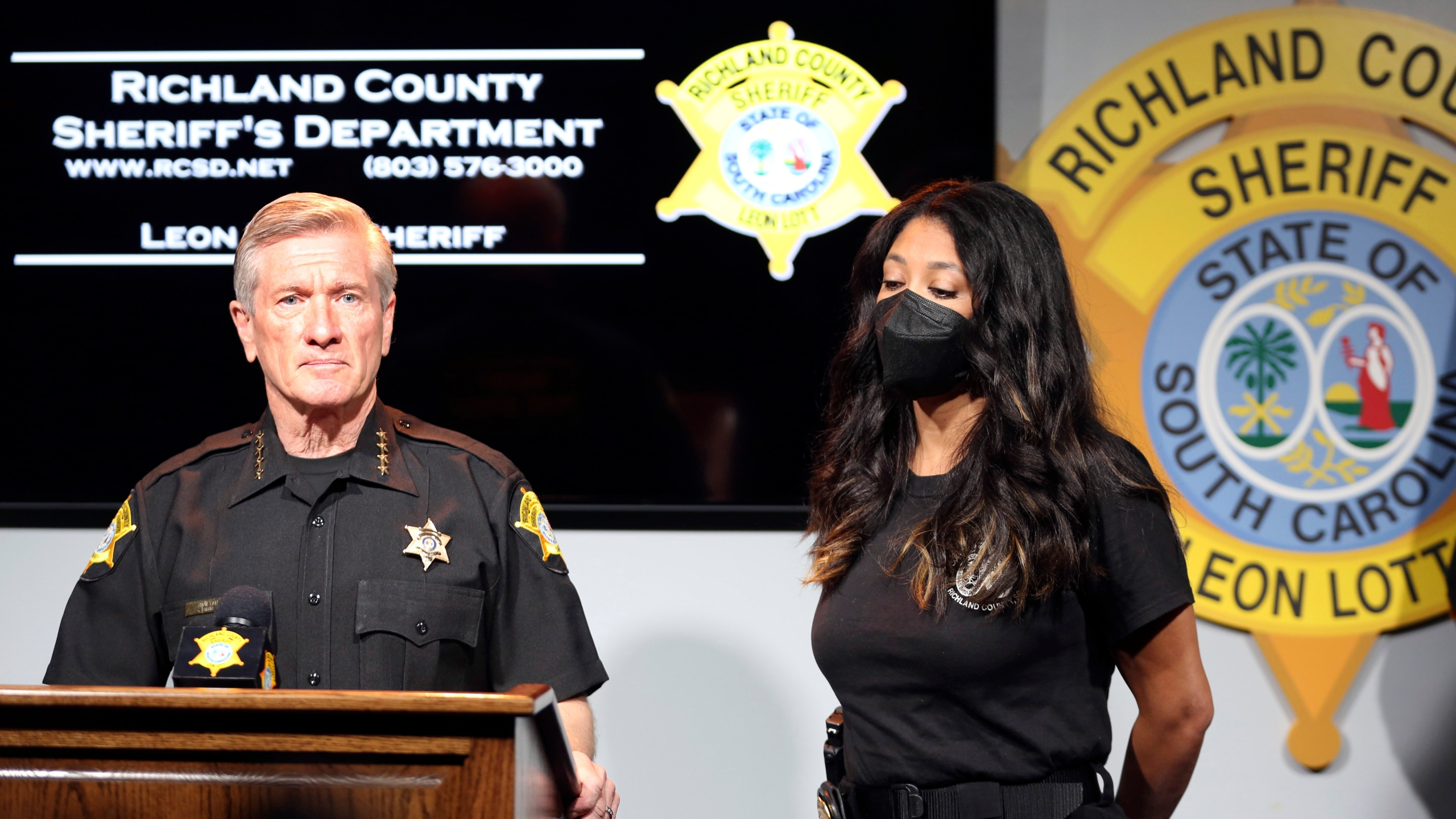 Richland County Sheriff Leon Lott, left, and Coroner Nadia Rutherford, right, talk about the heat deaths of two 20-month-old twin boys during a news conference on Tuesday, Sept. 21, 2021, in Columbia, S.C. Authorities ruled the deaths an accident after the father was distracted by intense pressure at work and no charges will be filed. (AP Photo/Jeffrey Collins)