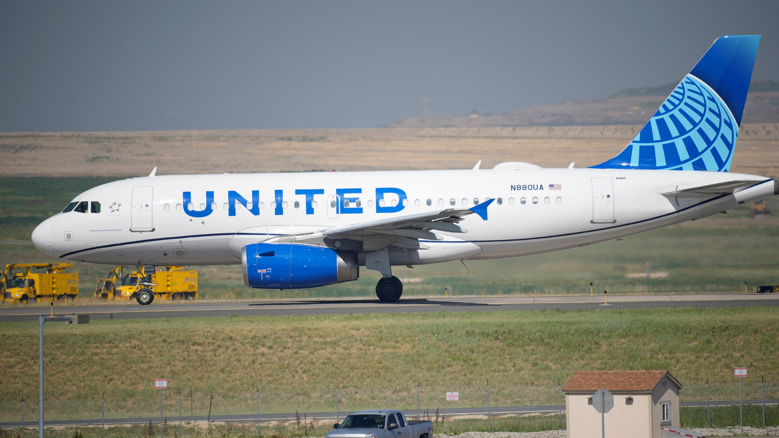 In this July 2, 2021 file photo, a United Airlines jetliner taxis down a runway for take off from Denver International Airport in Denver. The vast majority of United Airlines employees are deciding to get vaccinated against COVID-19 rather than risk losing their job. United said Wednesday, Sept. 22, that more than 97% of its U.S.-based employees are fully vaccinated. (AP Photo/David Zalubowski, file)