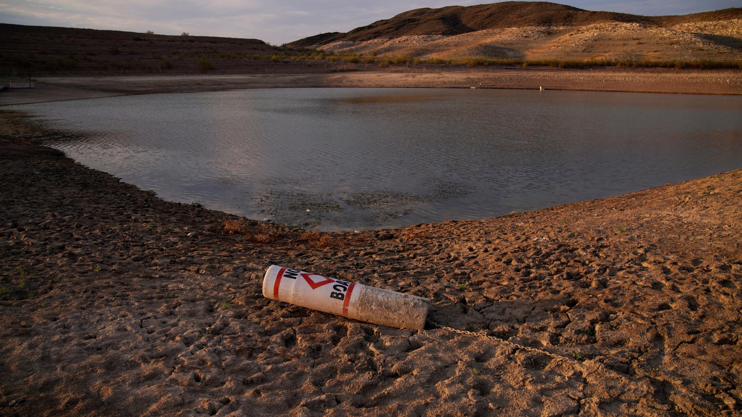 A buoy rests on the ground at a closed boat ramp on Lake Mead at the Lake Mead National Recreation Area near Boulder City, Nev., on Aug. 13, 2021. (John Locher / Associated Press)