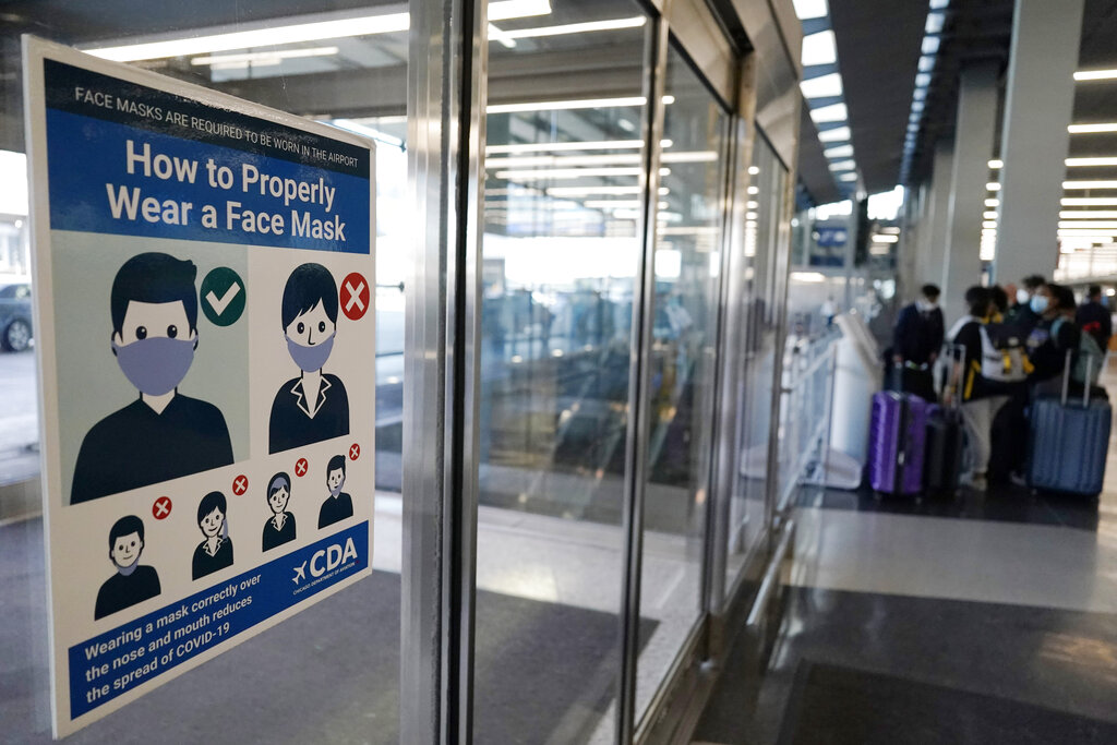 This July 2, 2021, file photo shows a sign stating face coverings are required is displayed at O'Hare airport in Chicago. (AP Photo/Nam Y. Huh, File)
