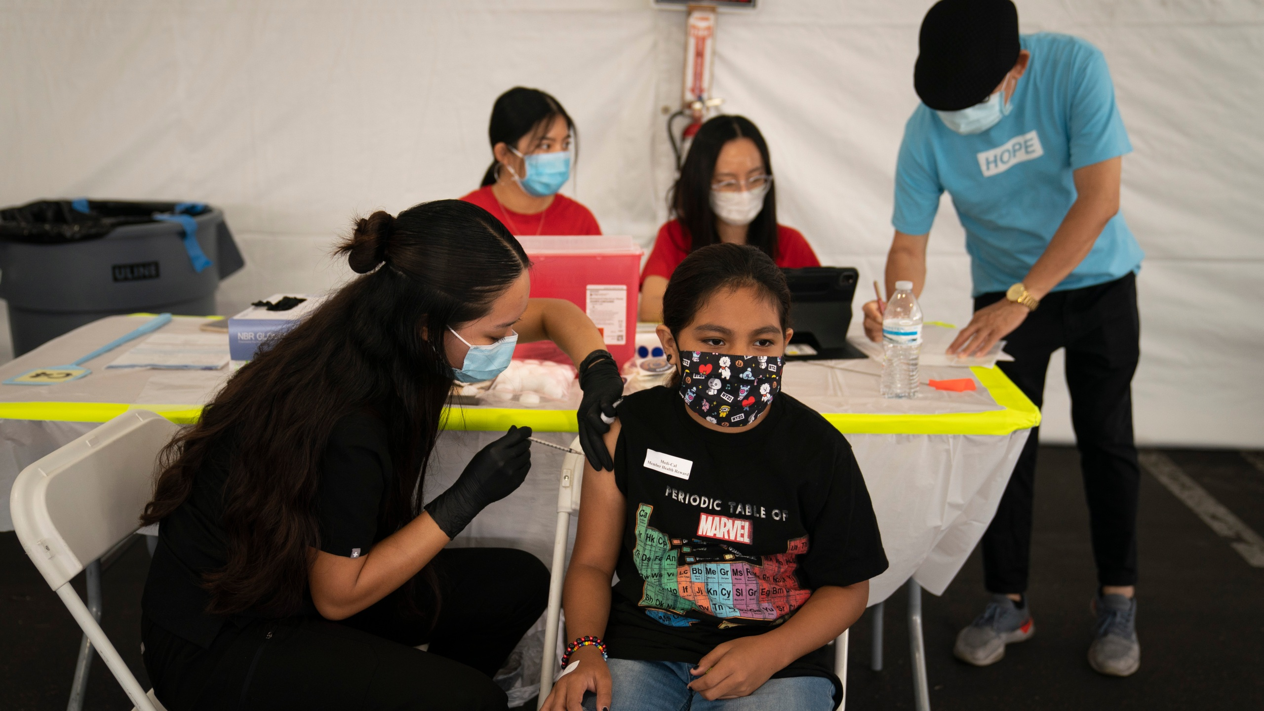 In this Aug. 28, 2021, file photo, Mayra Navarrete, 13, receives the Pfizer COVID-19 vaccine from registered nurse, Noleen Nobleza at a clinic set up in the parking lot of CalOptima in Orange, Calif. (AP Photo/Jae C. Hong, File)