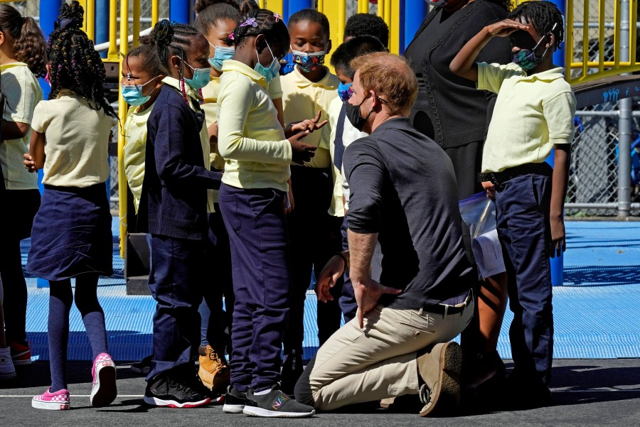 Prince Harry, the Duke of Sussex, chats with students during a visit to P.S. 123, the Mahalia Jackson School, in New York's Harlem neighborhood on Sept. 24, 2021. (AP Photo/Richard Drew)