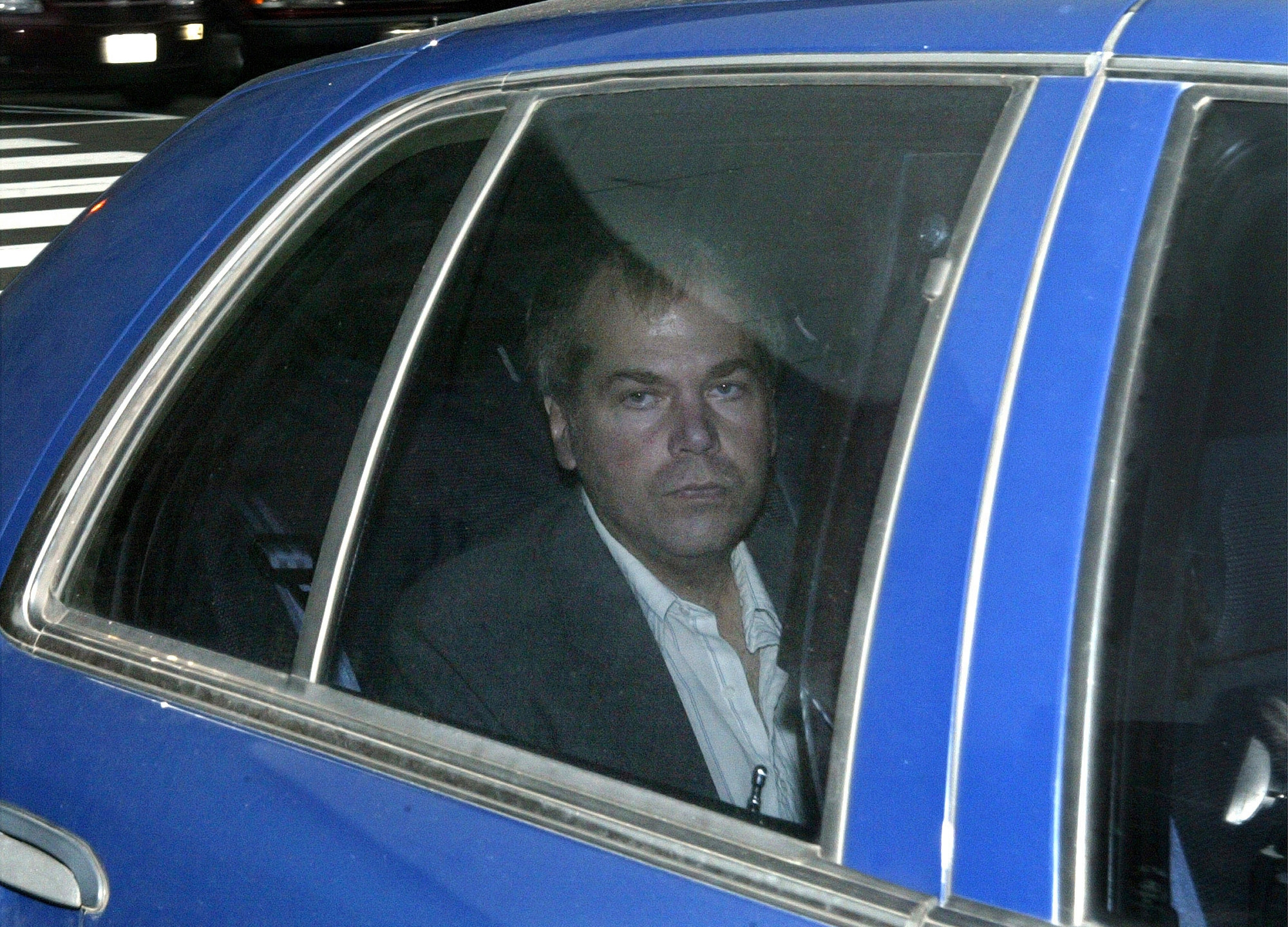 In this Nov. 18, 2003, file photo, John Hinckley Jr. arrives at U.S. District Court in Washington. Lawyers for Hinckley, the man who tried to assassinate President Ronald Reagan, are scheduled to argue in court Monday, Sept. 27, 2021, that the 66-year-old should be freed from restrictions placed on him after he moved out of a Washington hospital in 2016. (AP Photo/Evan Vucci, File)