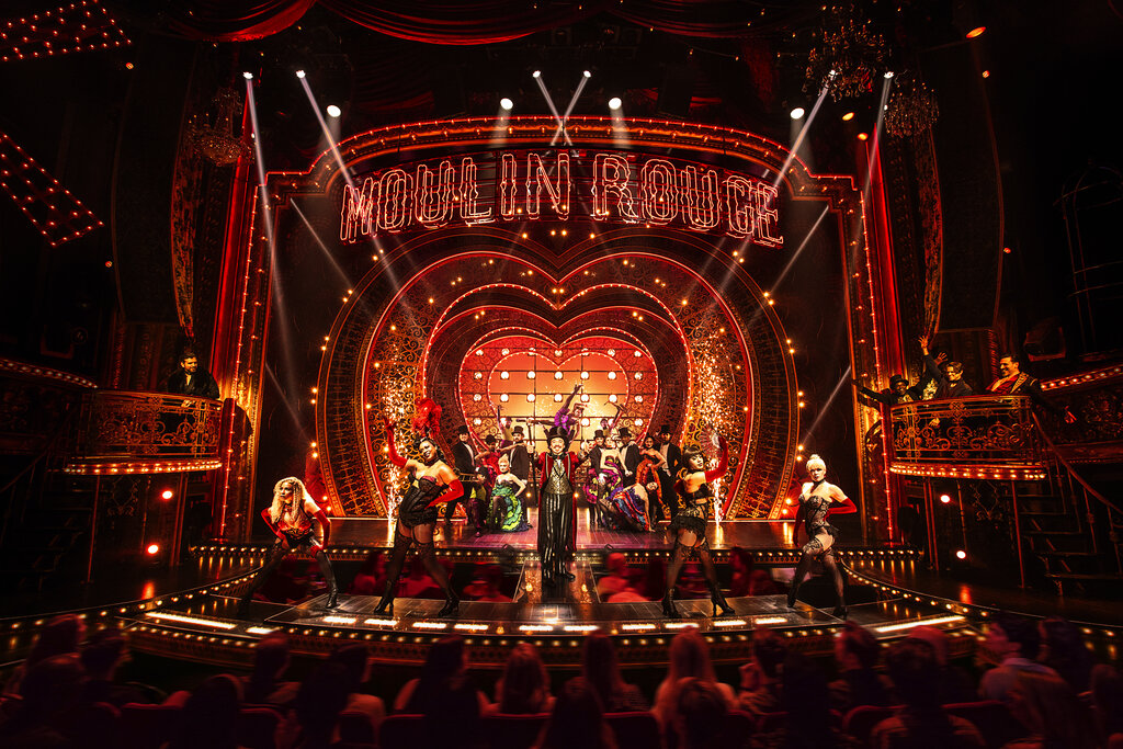 """This image released by Boneau/Bryan-Brown shows the cast in """"Moulin Rouge! The Musical."""" (Matthew Murphy/Boneau/Bryan-Brown via AP)"""