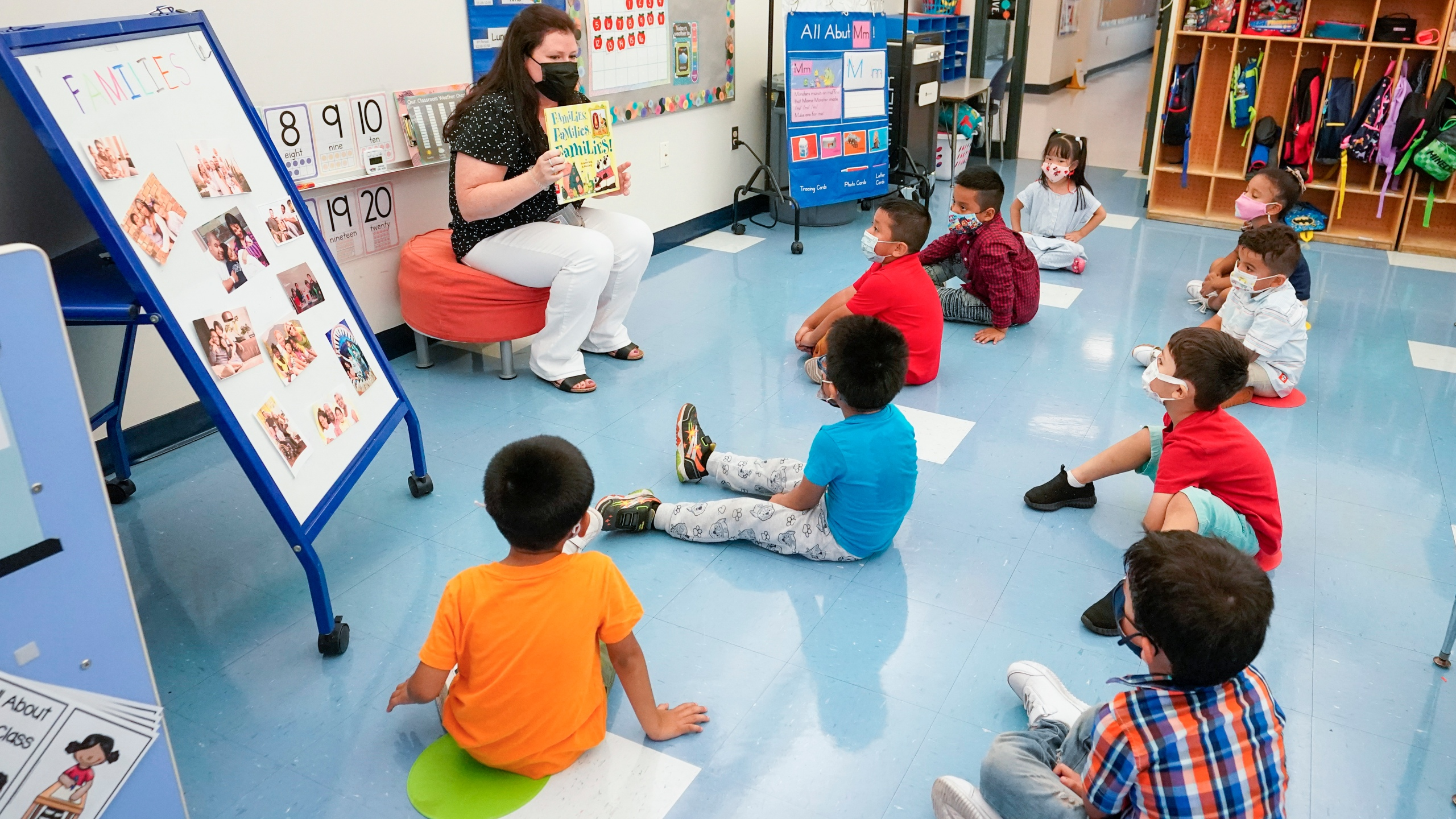 In this Sept. 16, 2021, file photo Pre-K teacher Vera Csizmadia teaches 3-and 4-year-old students in her classroom at the Dr. Charles Smith Early Childhood Center in Palisades Park, N.J. As Democrats push ahead with President Joe Biden's $3.5 trillion rebuilding plan, they are promising historic investments across all levels of education. The proposal includes universal prekindergarten, two years of free community college and expanded child care subsidies, among others. (AP Photo/Mary Altaffer, File)