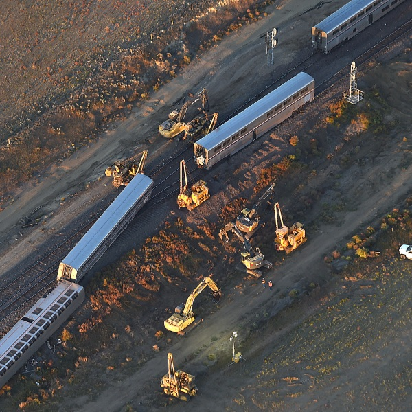 This aerial view taken Sunday, Sept. 26, 2021, shows part of an Amtrak train that derailed in north-central Montana Saturday that killed multiple people and left others hospitalized, officials said. (Larry Mayer/The Billings Gazette via AP)