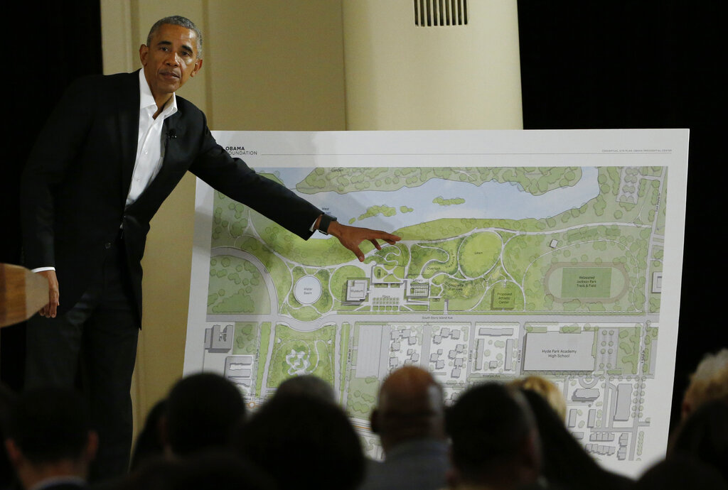In this May 3, 2017, file photo, former President Barack Obama points to a rendering for the former president's lakefront presidential center at a community event at the South Shore Cultural Center in Chicago. (AP Photo/Nam Y. Huh, File)