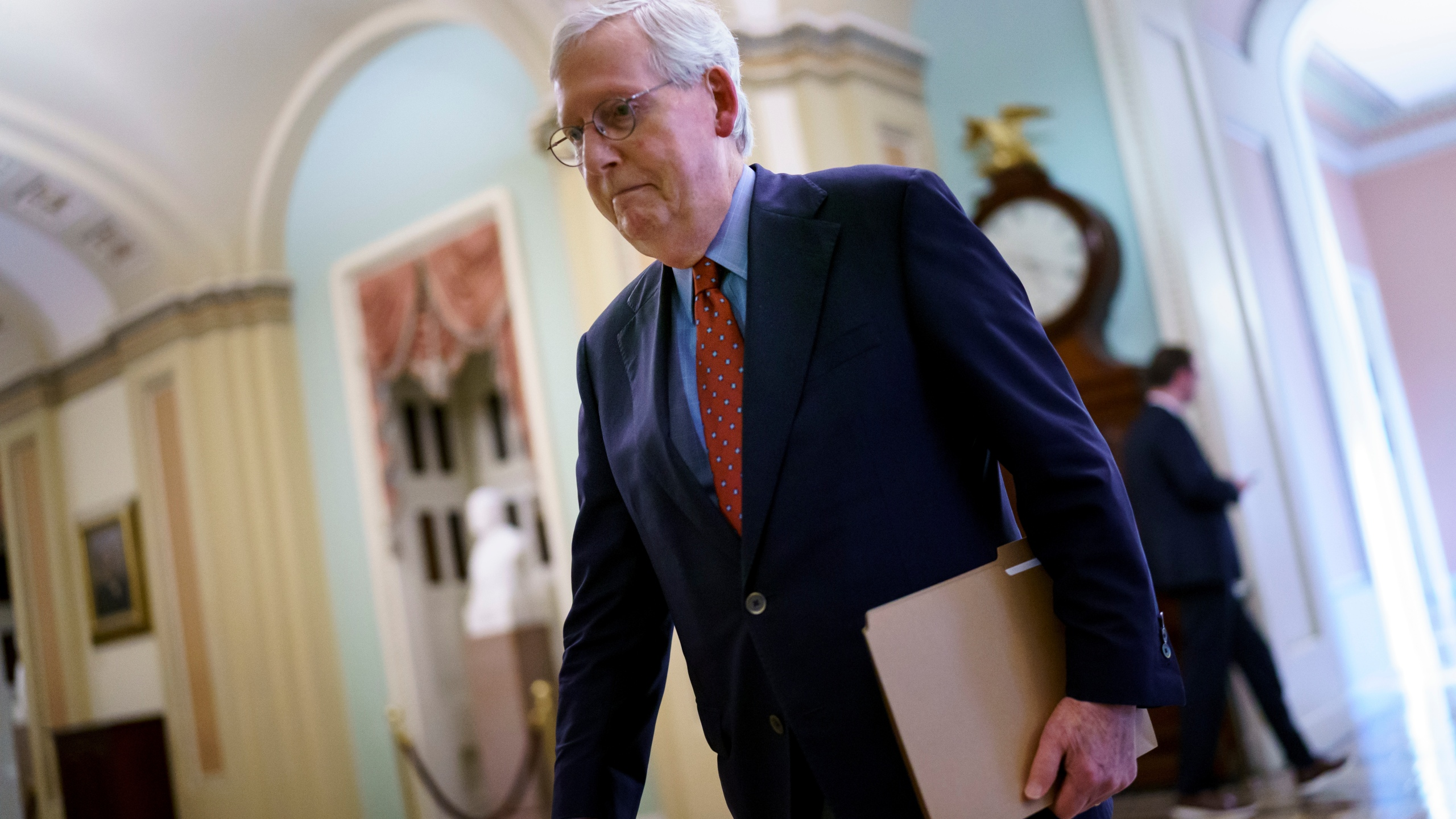 Senate Minority Leader Mitch McConnell, R-Ky., walks to the chamber for a test vote on a government spending bill at the Capitol in Washington on Sept. 27, 2021. (J. Scott Applewhite / Associated Press)