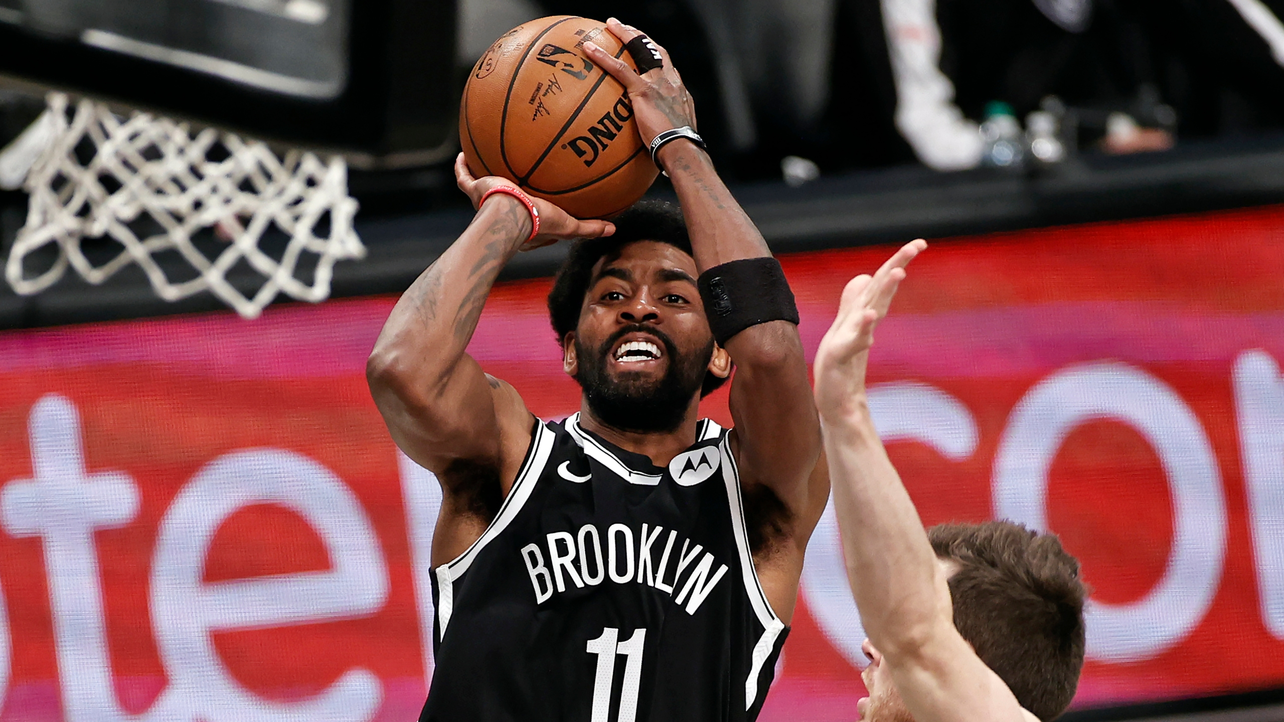 Brooklyn Nets guard Kyrie Irving (11) shoots against the Milwaukee Bucks during the second half of Game 1 of an NBA basketball second-round playoff series in New York, in this June 5, 2021, file photo. Players like Kyrie Irving, who has refused to say if he will be vaccinated against COVID-19, will be subject to testing on all NBA practice, travel and game days this season. (AP Photo/Adam Hunger, File)