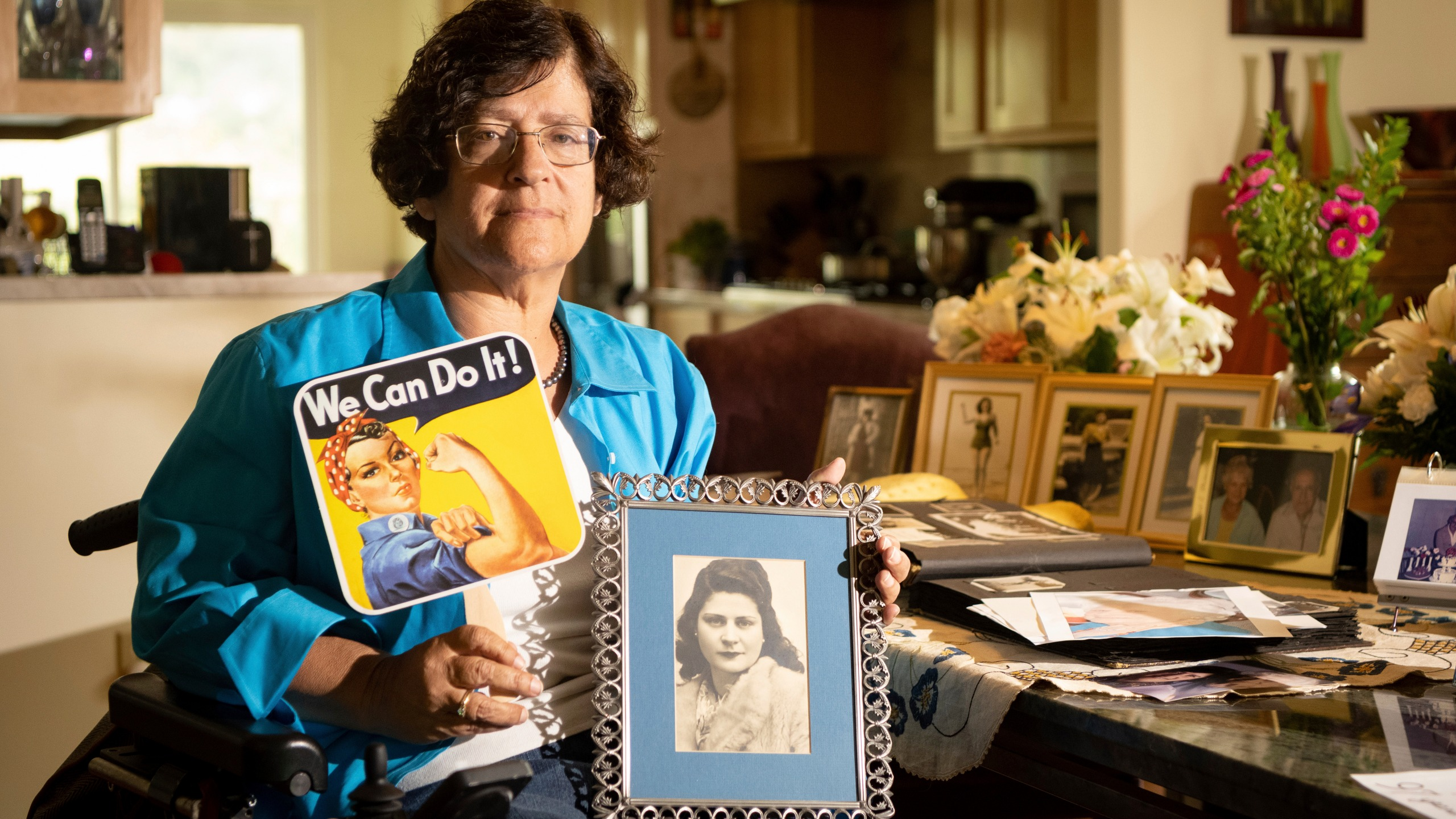 Dorene Giacopini holds up a photo of her mother Primetta Giacopini while posing for a photo at her home in Richmond, Calif. on Monday, Sept 27, 2021. Primetta Giacopini's life ended the way it began — in a pandemic. She was two years old when she lost her mother to the Spanish flu in Connecticut in 1918. Giacopini contracted COVID-19 earlier this month. The 105-year-old struggled with the disease for a week before she died Sept. 16. (AP Photo/Josh Edelson)