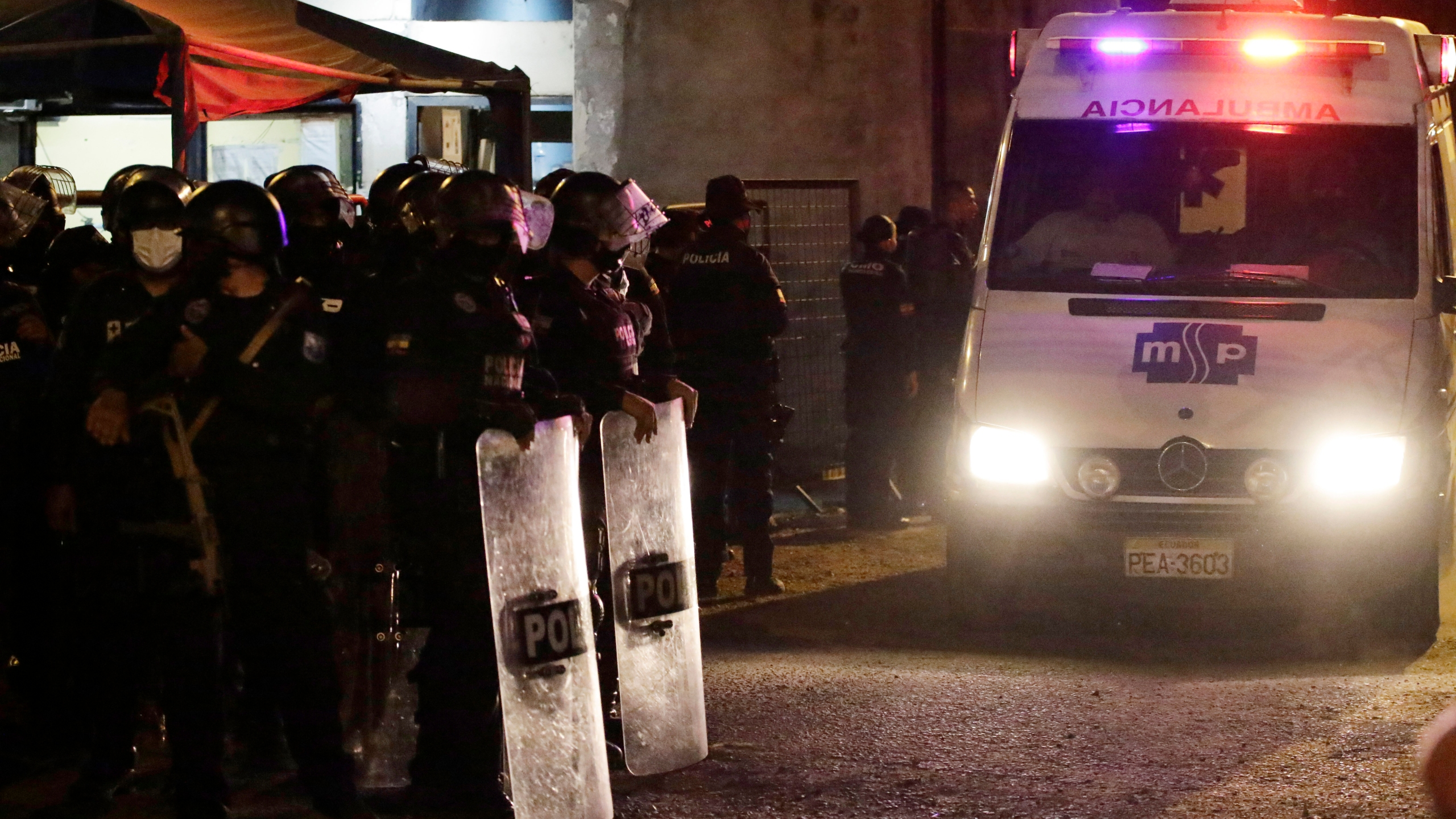 An ambulance leaves from the Litoral penitentiary after a riot, in Guayaquil, Ecuador on Sept. 28, 2021. (AP Photo/Angel DeJesus)