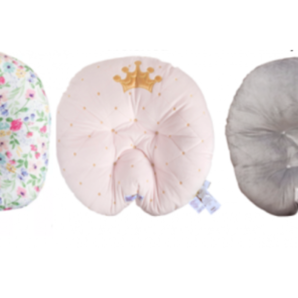 The Boppy Original Newborn Lounger (left), Boppy Preferred Newborn Lounger (center), and Pottery Barn Kids Boppy Newborn Lounger (right) are seen in an image provided by the U.S. Consumer Product Safety Commission on Sept. 23, 2021.