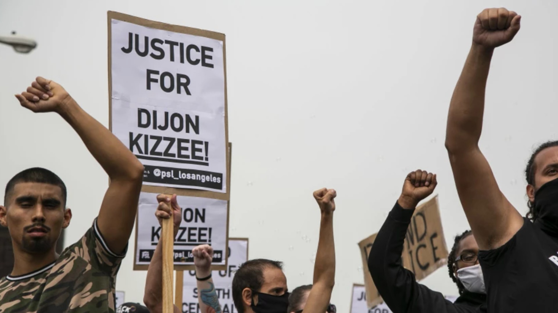 Protesters raise their fists as they march down Vermont Ave. during a protest calling for justice and in honor of Dijon Kizzee on Sept. 12, 2020, in South Los Angeles. Kizzee was killed by L.A. County sheriff's deputies in the Westmont area. (Josie Norris / Los Angeles Times)