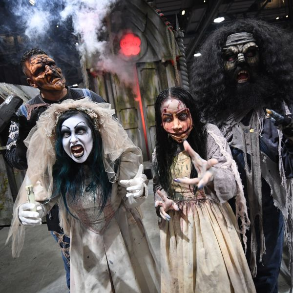 Actors from Knott's Scary Farm pose at the annual 'Midsummer Scream Horror Convention' in Long Beach, California, on July 29, 2018. (Mark RALSTON / AFP via Getty Images)