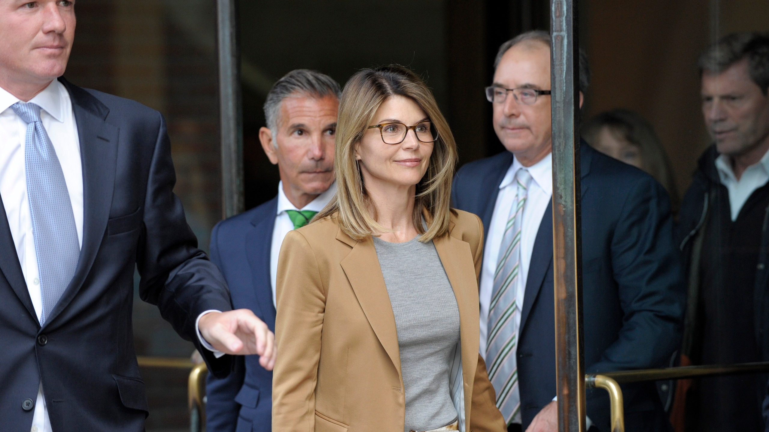 Actress Lori Loughlin exits the courthouse after facing charges for allegedly conspiring to commit mail fraud and other charges in the college admissions scandal at the John Joseph Moakley United States Courthouse in Boston on April 3, 2019. (Joseph Prezioso/AFP via Getty Images)
