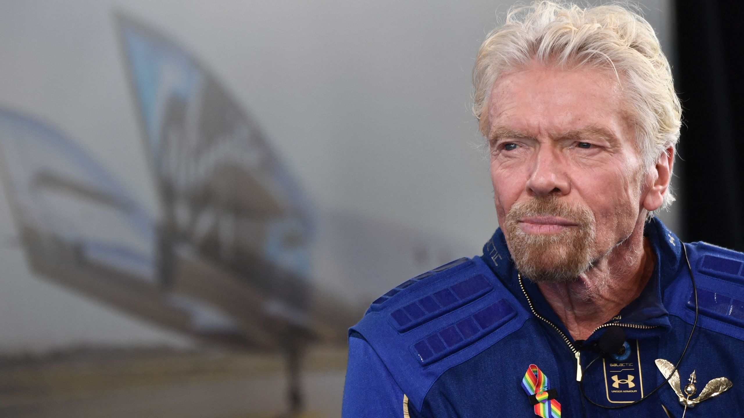 """Richard Branson speaks after he flew into space aboard a Virgin Galactic vessel, a voyage he described as the """"experience of a lifetime"""" near Truth and Consequences, New Mexico on July 11, 2021.(PATRICK T. FALLON/AFP via Getty Images)"""
