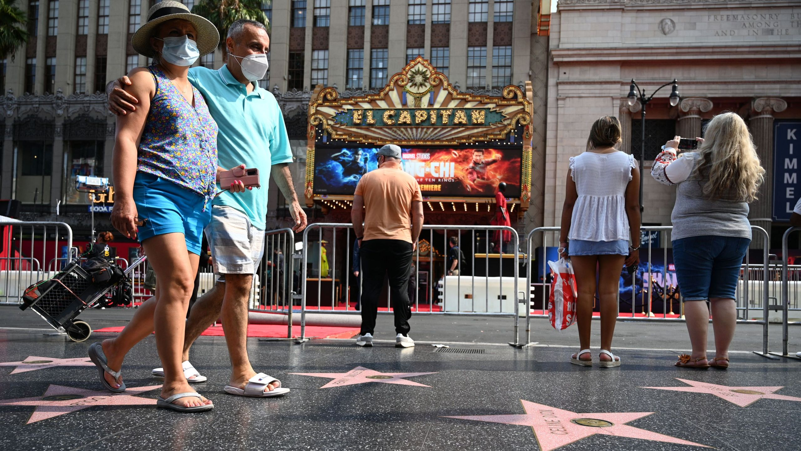 Tourists walk on Hollywood Boulevard's Walk of Fame on Aug. 16, 2021. (Robyn Beck / AFP / Getty Images)