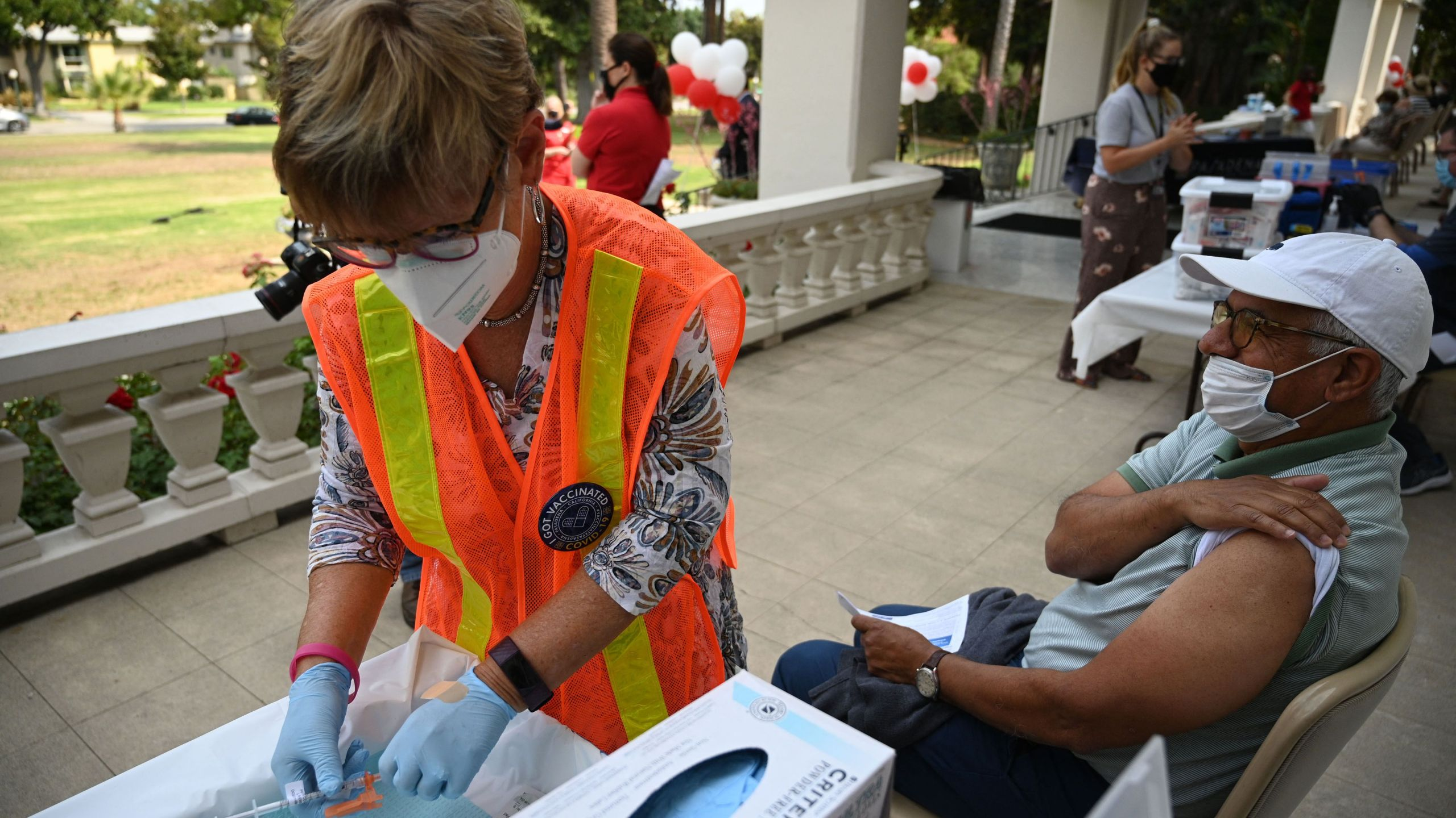 A nurse prepares a first dose of the Pfizer COVID-19 vaccine for Jose Luis Sanchez at a clinic hosted by The Tournament of Roses in partnership with the Pasadena Public Health Department on Aug. 19, 2021 at Tournament House in Pasadena. (ROBYN BECK/AFP via Getty Images)