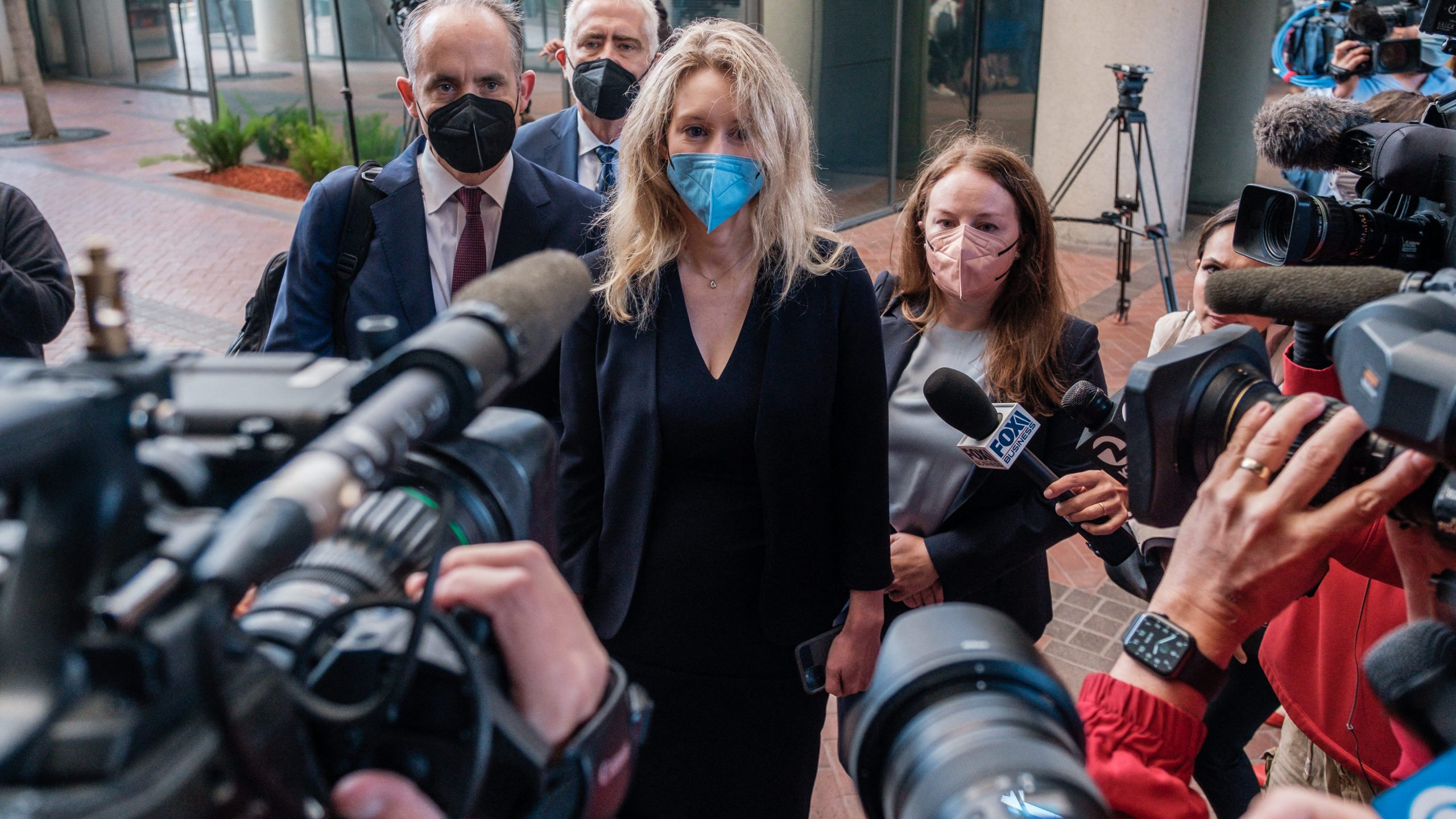 Elizabeth Holmes, the founder and former CEO of blood testing and life sciences company Theranos, arrives for the first day of jury selection in her fraud trial, outside Federal Court in San Jose, California, on Aug. 31, 2021. (NICK OTTO/AFP via Getty Images)