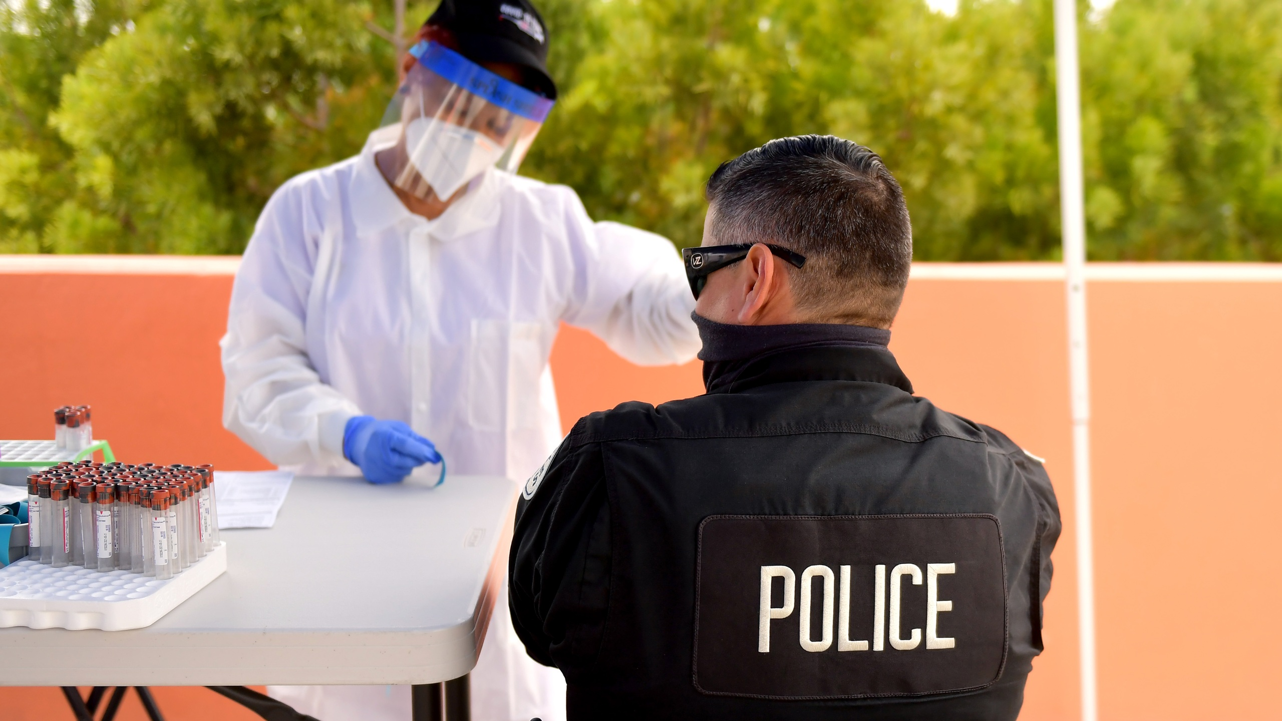 A police officer is seen at a free COVID-19 SARS-CoV-2 serology antibody testing community event, hosted by GUARDaHEART Foundation and Baldwin Hills Crenshaw Plaza, at Baldwin Hills Crenshaw Plaza on August 05, 2020 in Los Angeles, California. (Matt Winkelmeyer/Getty Images)
