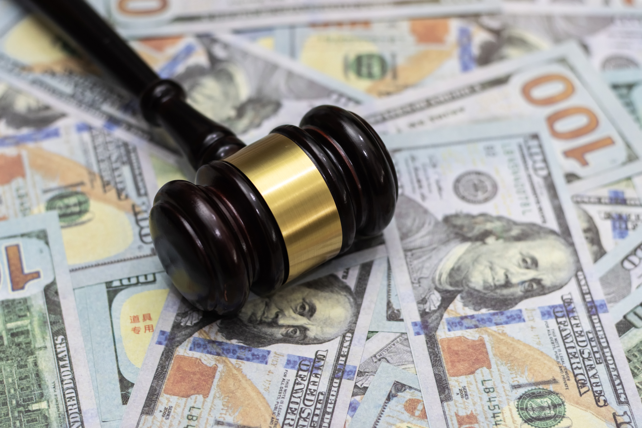 Wooden gavel and dollar banknotes are seen in this file image. (Getty Images)