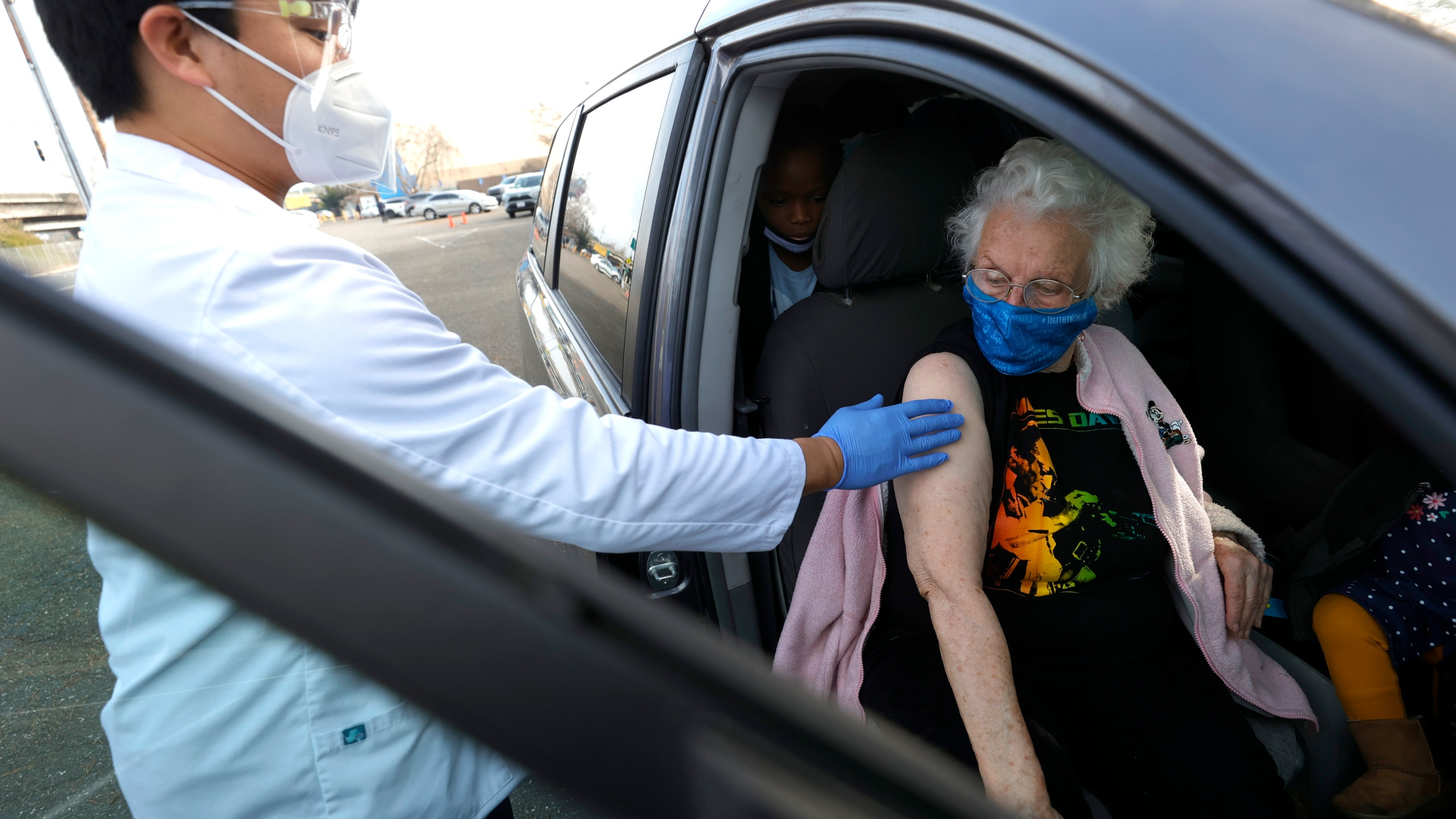 A pharmacist prepares to administer a COVID-19 vaccination during a drive-thru vaccination clinic at the Sonoma County Fairgrounds on Jan. 13, 2021 in Santa Rosa. (Justin Sullivan/Getty Images)