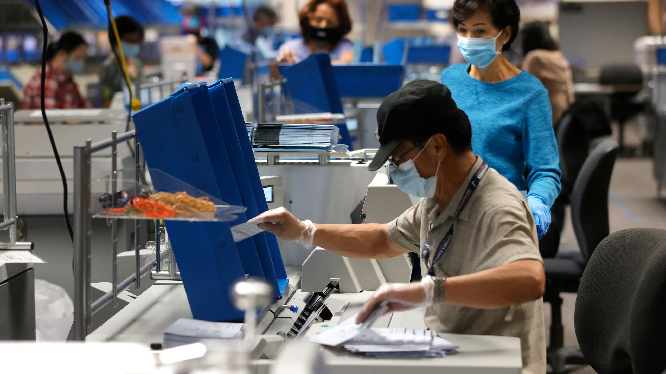 Workers sort through mail-in-ballots at the Santa Clara County registrar of voters office on Aug. 25, 2021 in San Jose, California. (Justin Sullivan/Getty Images)