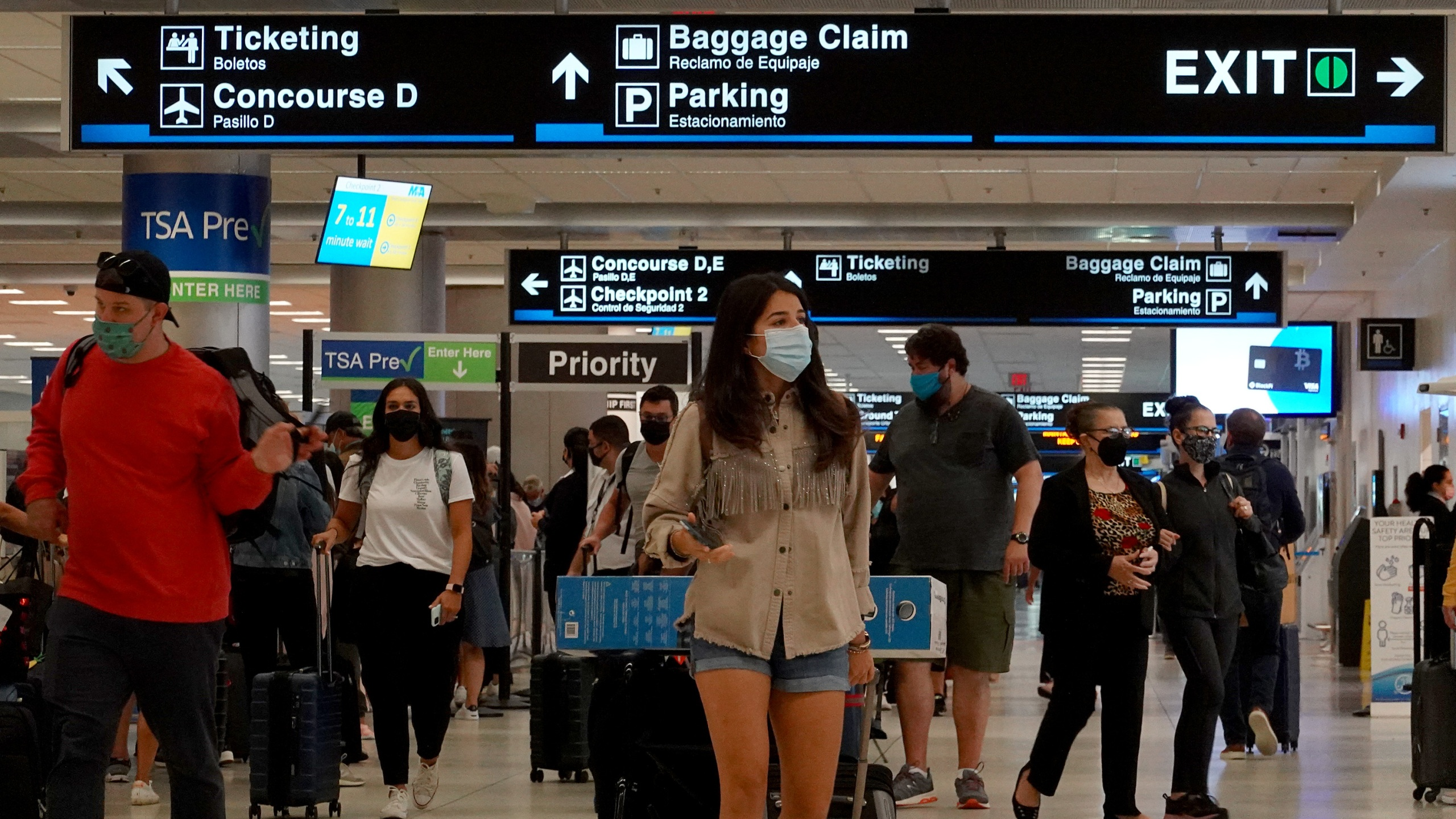 Travelers make their way through the Miami International Airport on Sept. 3, 2021 in Miami, Florida. (Joe Raedle/Getty Images)