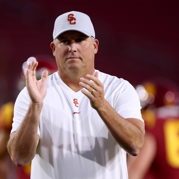 Head coach of the USC Trojans Clay Helton cheers on his team during warm up before the game against the Stanford Cardinal at Los Angeles Memorial Coliseum on Sept. 11, 2021 in Los Angeles. (Harry How/Getty Images)