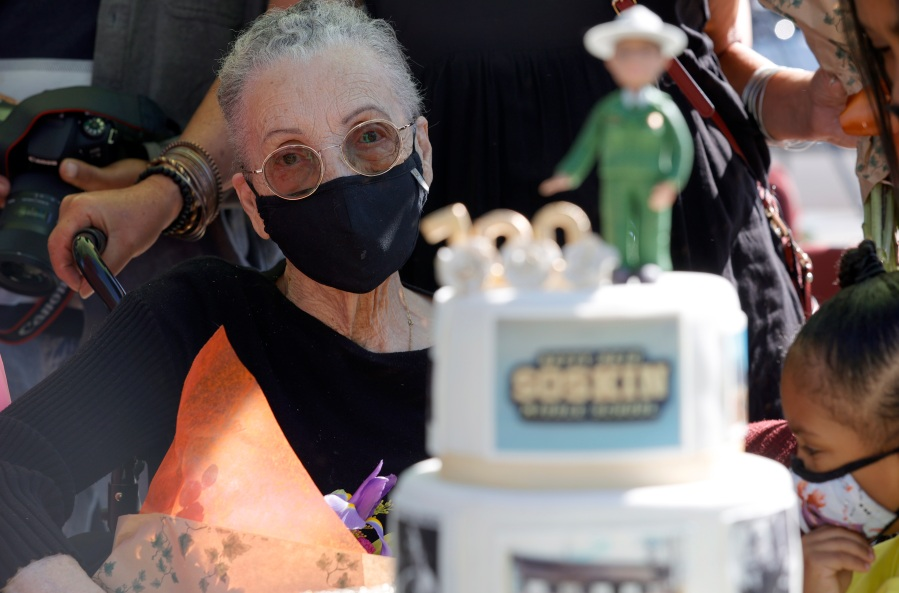 Betty Reid Soskin, the oldest full-time National Park Service ranger in the United States, looks at a birthday cake during a ceremony for the newly renamed Betty Reid Soskin Middle School on Sept. 22, 2021, in El Sobrante, California. Soskin had the school renamed after her on her 100th birthday. (Justin Sullivan/Getty Images)