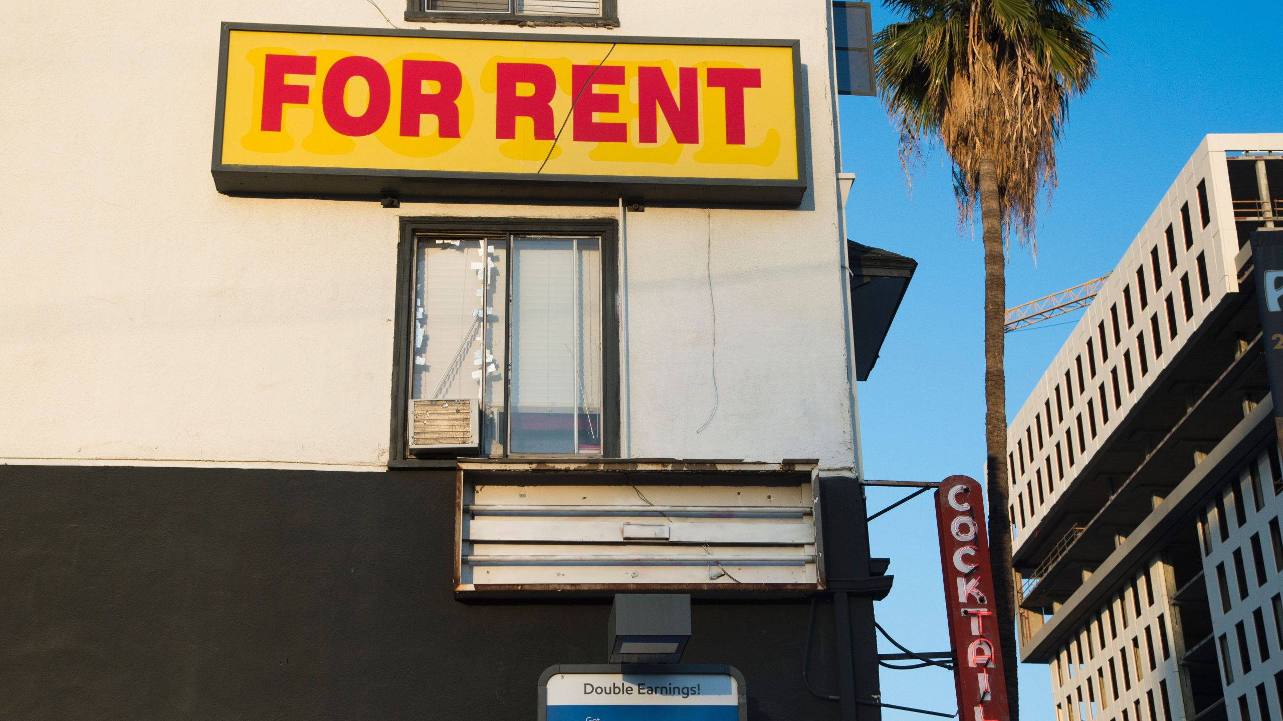 """A """"For Rent"""" sign is seen on a building Hollywood, California, May 11, 2016.(ROBYN BECK/AFP via Getty Images)"""
