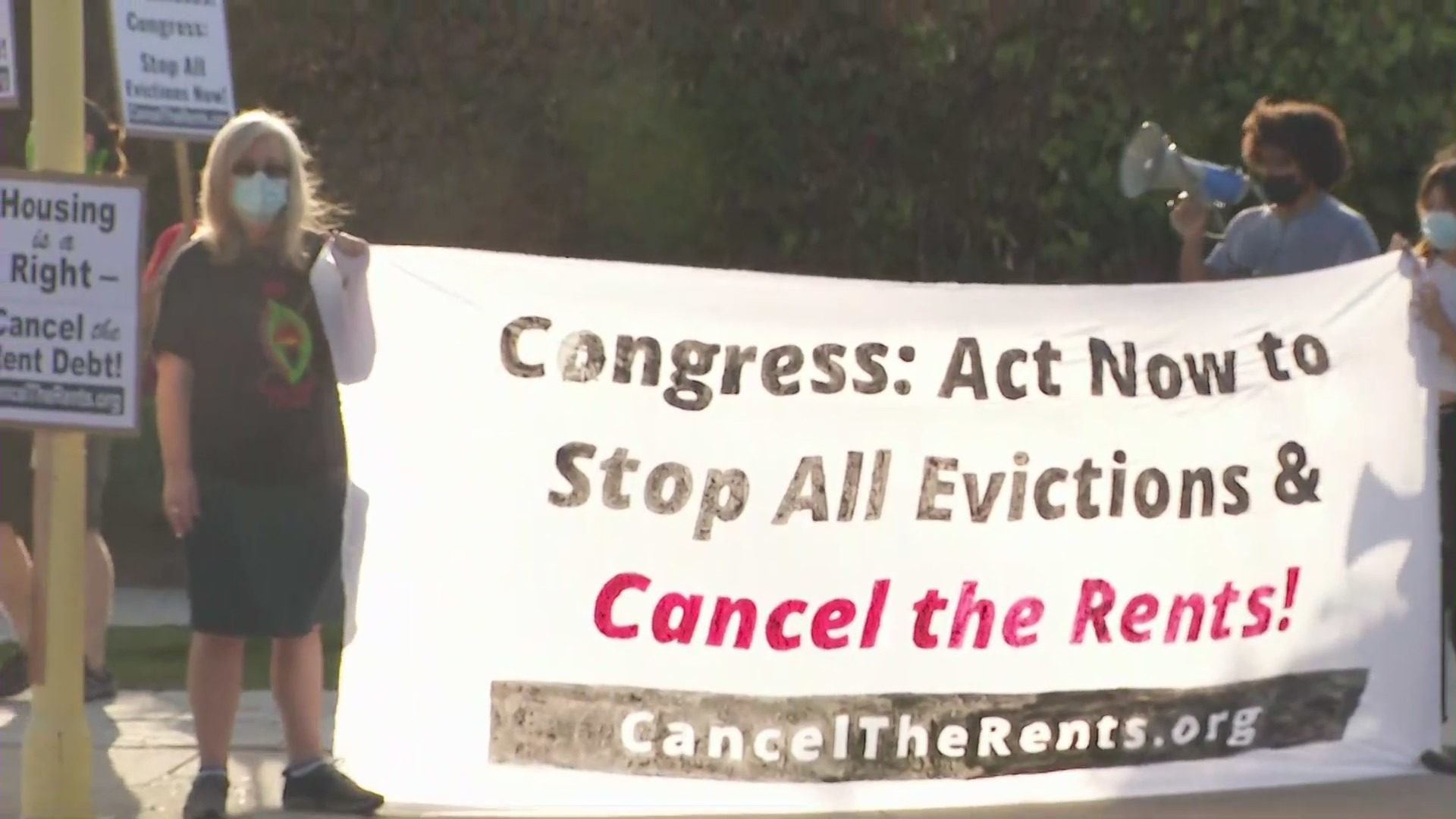 Protesters in Alhambra on Sept. 25, 2021 want more action taken to prevent people from being kicked out of their homes due to the pandemic. (KTLA)