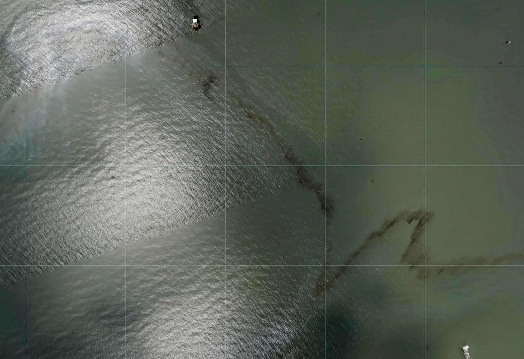 Photos captured by National Oceanic and Atmospheric Administration aircraft Tuesday, Aug. 31, 2021 and reviewed by The Associated Press show a miles long black slick floating in the Gulf of Mexico near a large rig marked with the name Enterprise Offshore Drilling. The company, based in Houston, did not immediately respond to requests for comment by phone or email on Wednesday. EPA officials said Wednesday hey were unaware of any leak requiring a federal response. (NOAA via AP)