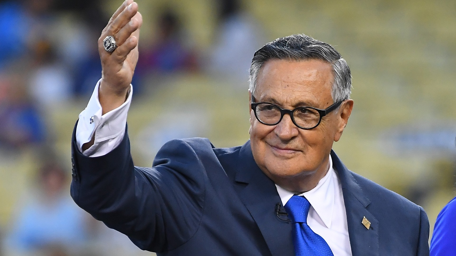 Longtime Los Angeles Dodgers broadcaster Jaime Jarrin acknowledges the crowd after being inducted into the Dodger Stadium Ring of Honor the game against the San Diego Paders at Dodger Stadium on September 2, 2018. (Jayne Kamin-Oncea/Getty Images)