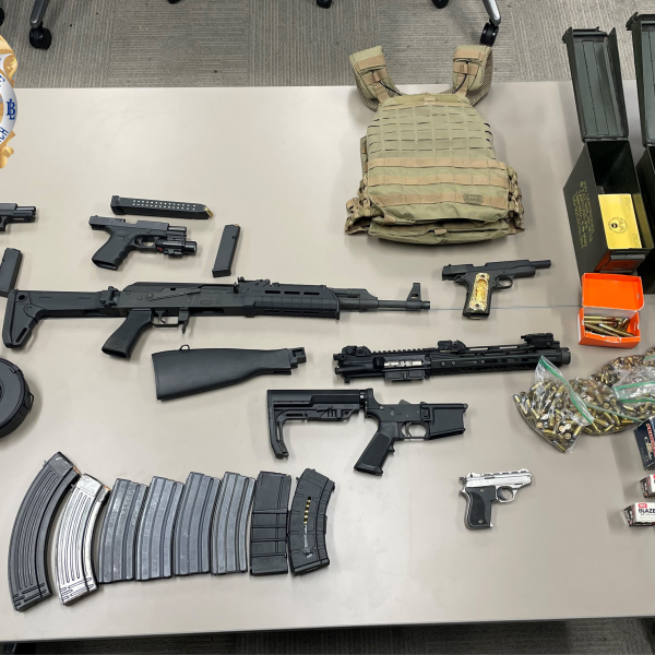 When investigating a pair of murders, the Long Beach Police Department found multiple guns and drugs, police said. (LBPD)
