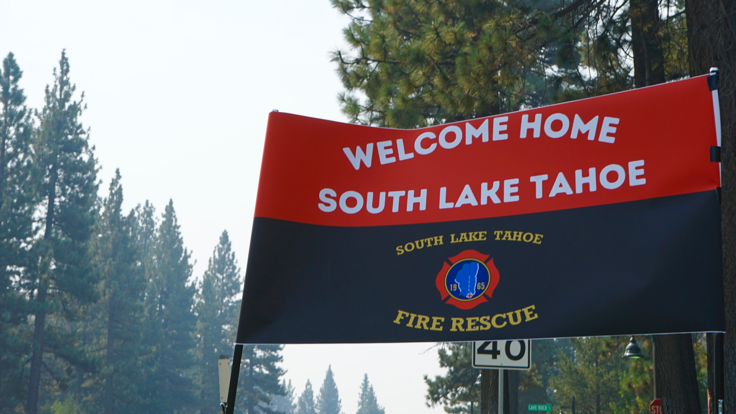 A sign outside a South Lake Tahoe Fire Station welcomes residents back to town after the lifting of the evacuation order Monday, Sept. 6, 2021. The resort town of some 22,000 was cleared last week due to the Caldor Fire. (AP Photo/Samuel Metz)