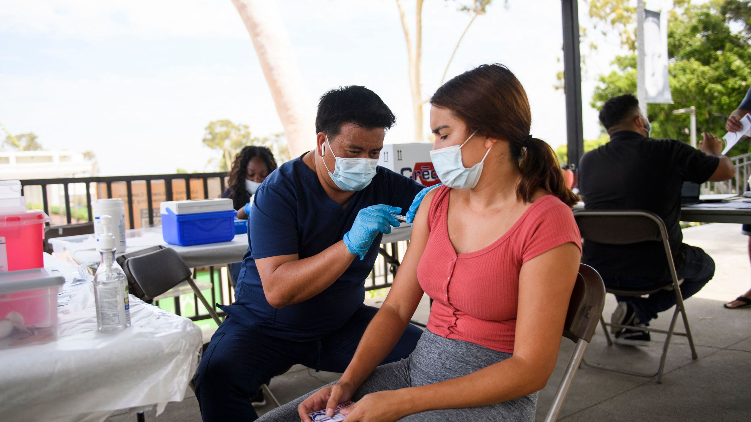 A CSULB student receives a first dose of the Pfizer Covid-19 vaccine during a City of Long Beach Public Health Covid-19 mobile vaccination clinic at the California State University Long Beach (CSULB) campus on Aug. 11, 2021 in Long Beach, California. - Students, staff, and faculty at the California State University (CSU) and University of California (UC) system schools will be required to be fully vaccinated in order to attend in-person classes. All teachers in California will have to be vaccinated against Covid-19 or submit to weekly virus tests, the state's governor announced June 11, as authorities grapple with exploding infection rates. (Photo by Patrick T. FALLON / AFP) (Photo by PATRICK T. FALLON/AFP via Getty Images)