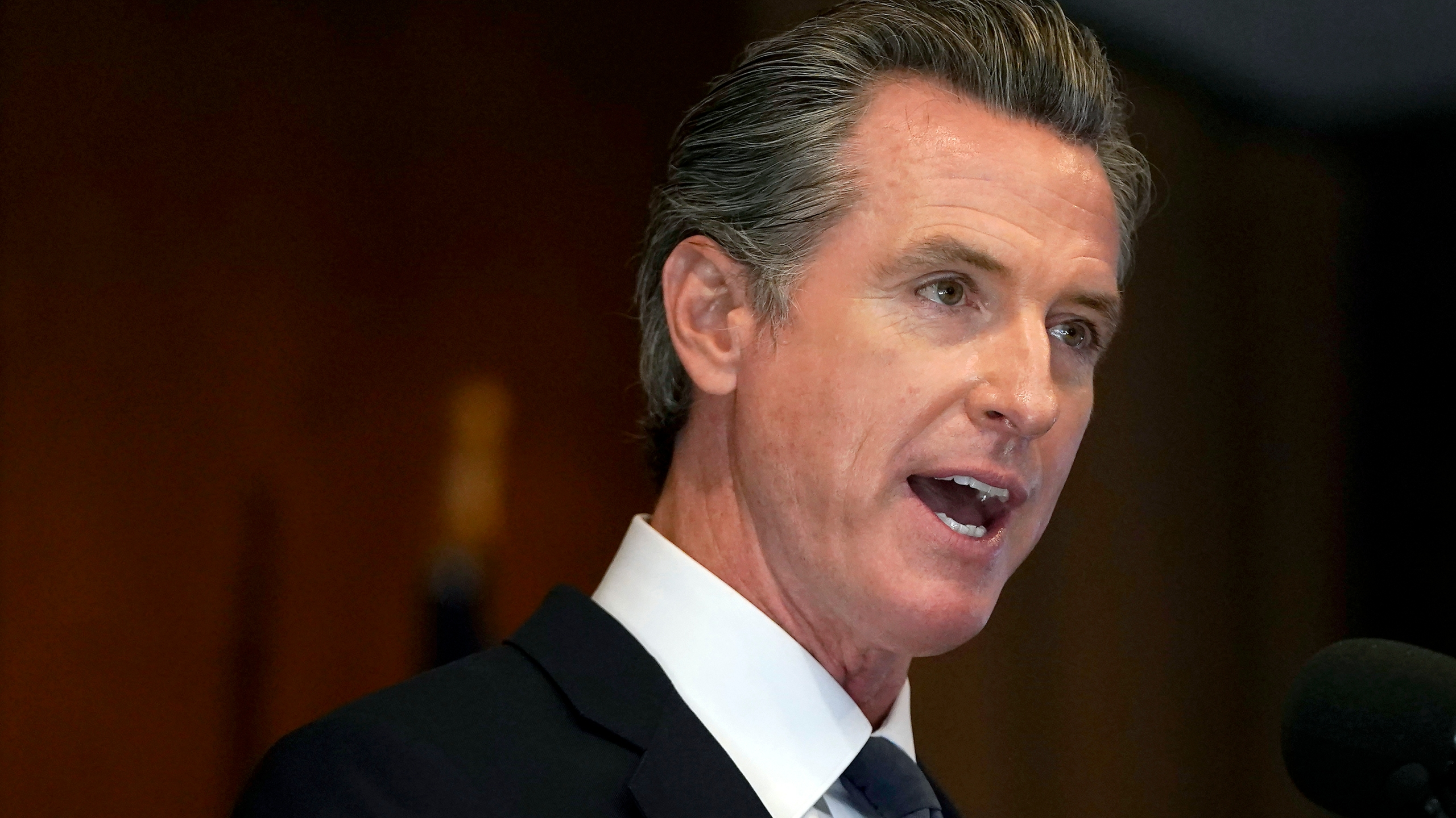 """In this Sept. 14, 2021, file photo, California Gov. Gavin Newsom speaks in San Francisco. On Friday, Sept. 24, 2021, Newsom signed a law replacing the word """"alien"""" in state law when referring to noncitizens. Newsom said the term is outdated and derogatory. The word will be replaced with words like """"noncitizen"""" and """"immigrant."""" U.S. President Joe Biden ordered federal immigration agencies to stop using the word """"alien"""" earlier this year. (AP Photo/Jeff Chiu)"""