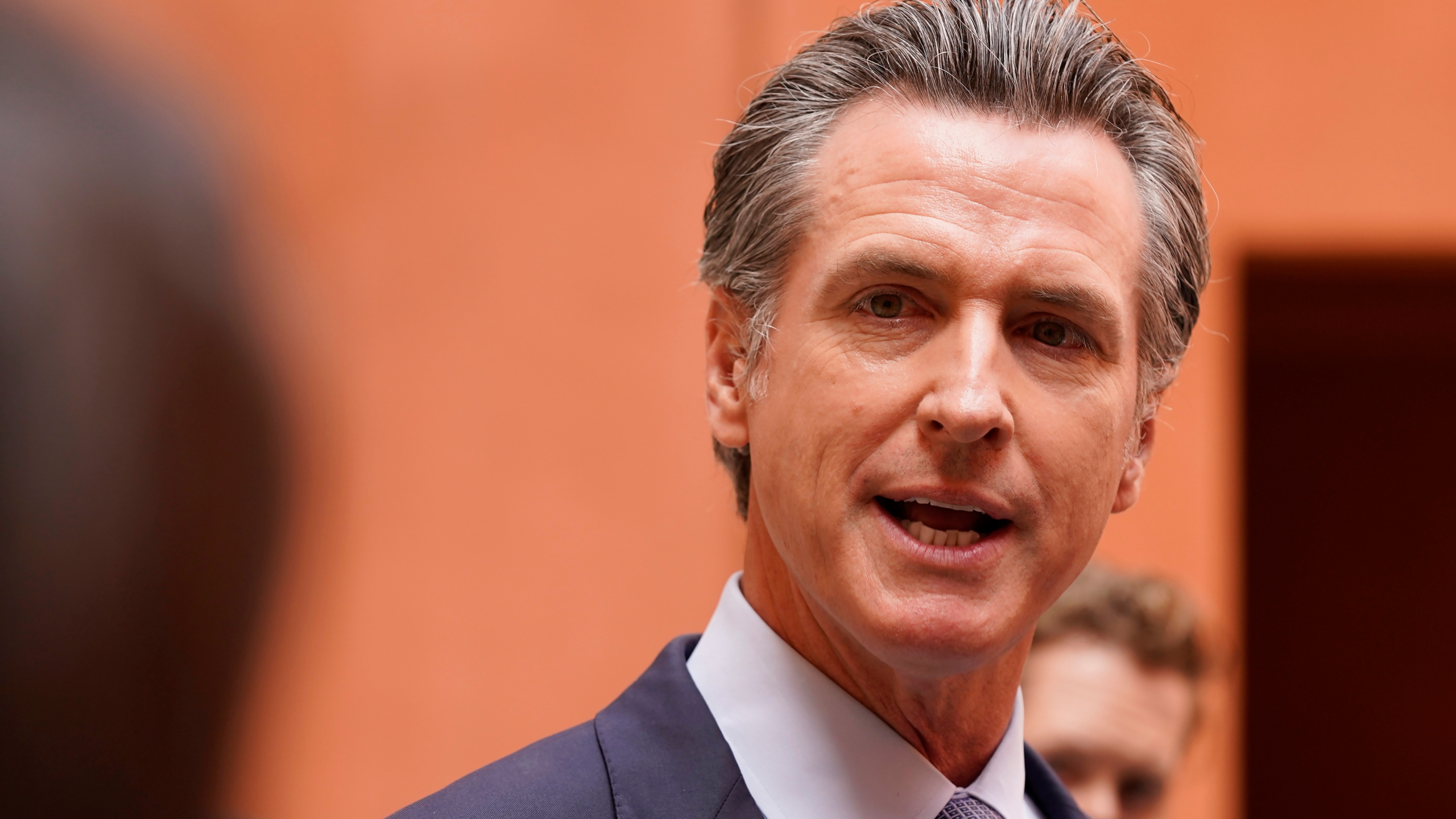 """California Gov. Gavin Newsom responds to a question while meeting with reporters after casting his recall ballot at a voting center in Sacramento, Calif., Friday, Sept. 10, 2021. The last day to vote in the recall election is Tuesday Sept. 14. A majority of voters must mark """"no"""" on the recall to keep Newsom in office. (AP Photo/Rich Pedroncelli)"""