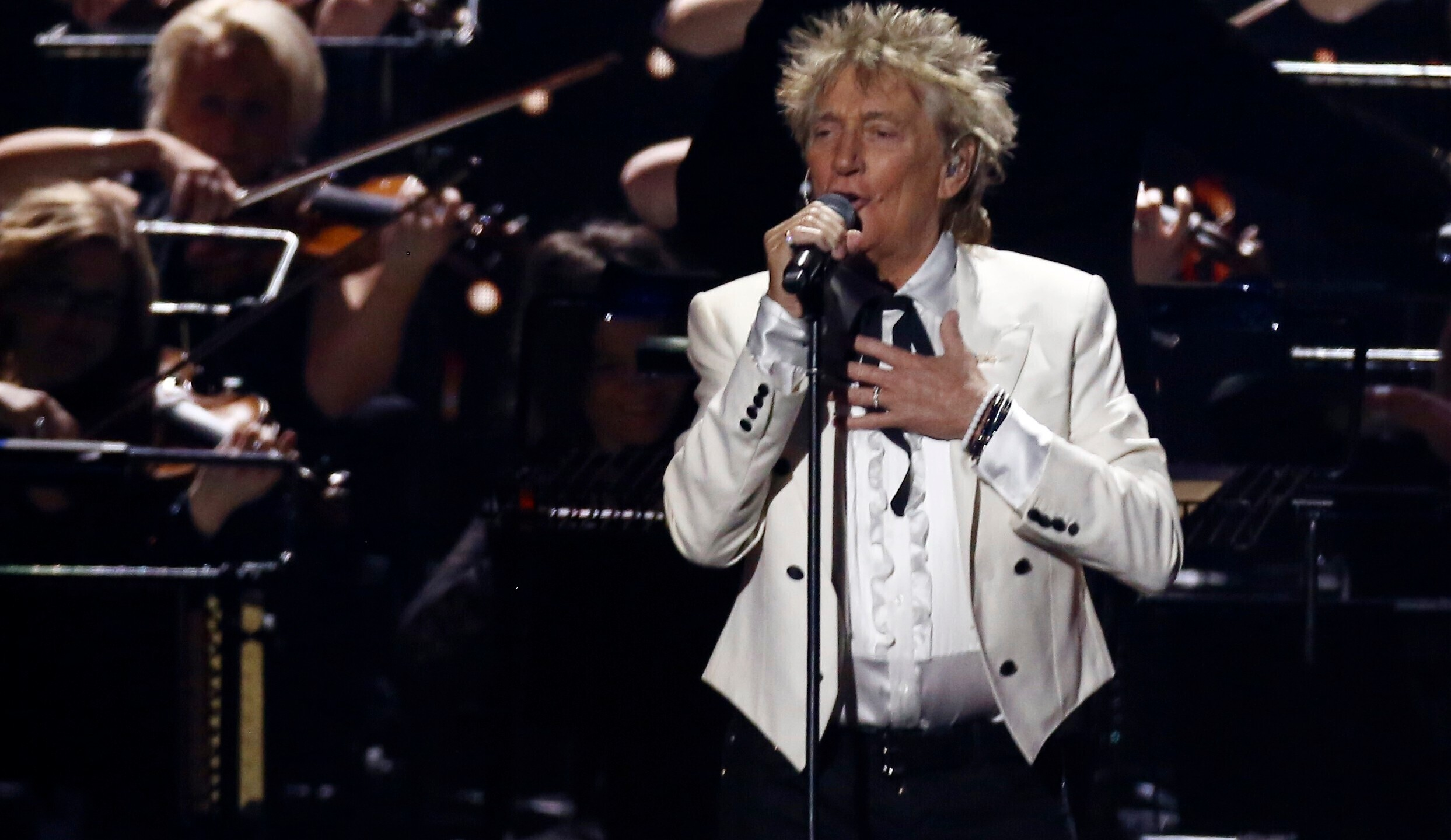 """In this Feb. 18, 2020 file photo, Rod Stewart performs on stage at the Brit Awards 2020 in London. A Florida judge on Thursday, Sept. 9, 2021, has canceled the trial for Stewart and his adult son and scheduled a hearing next month to discuss a plea deal to resolve misdemeanor charges. The singer of 70s hits such as """"Da Ya Think I'm Sexy?"""" and """"Maggie May"""" and his son are accused of pushing and shoving a security guard at an upscale hotel because he wouldn't let them into a New Year's Eve party nearly two years ago. (Joel C Ryan/Invision/AP)"""