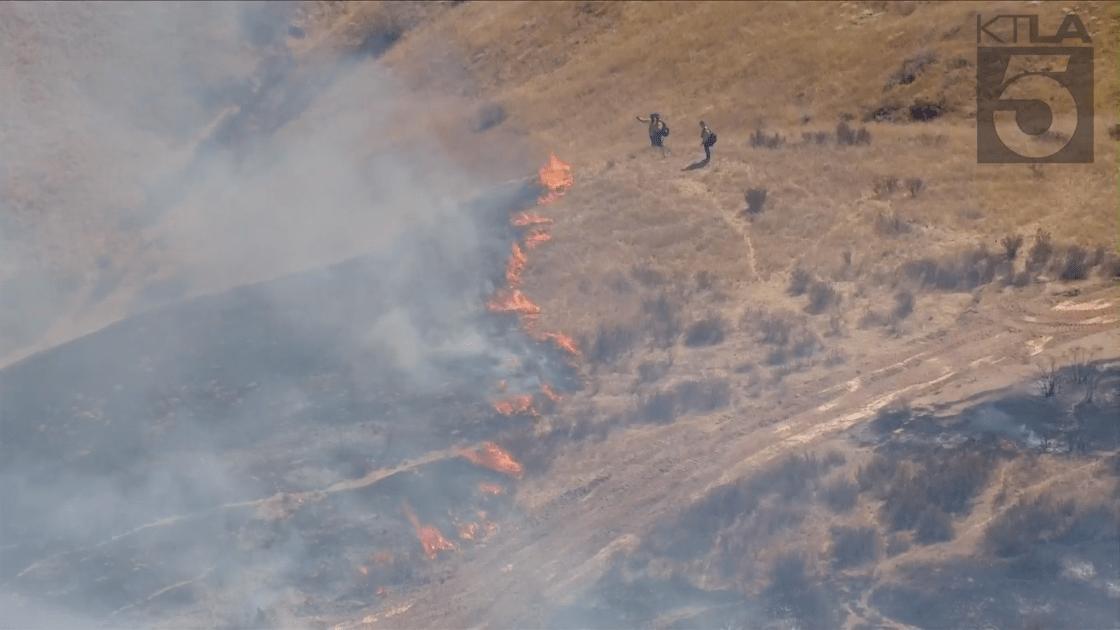 Firefighters were battling a blaze near the 215 Freeway in San Bernardino on Sept. 22, 2021. (KTLA)