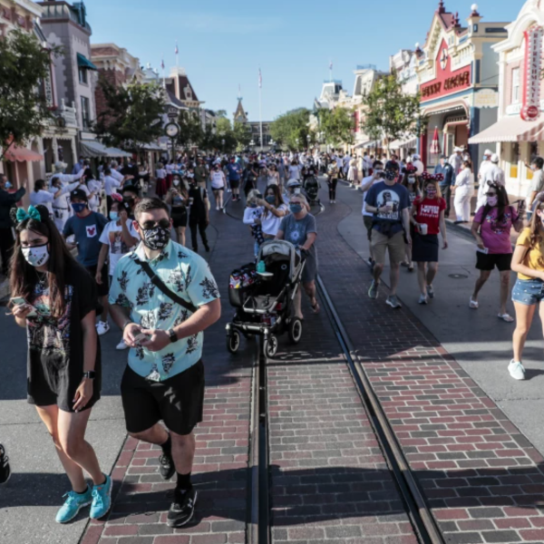 Disney fans stream into the park on the first day Disneyland opened after closing for more than a year. Wait times for many of the rides have dropped. (Robert Gauthier / Los Angeles Times)