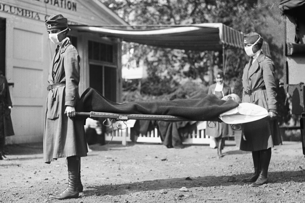 This photo made available by the Library of Congress shows a demonstration at the Red Cross Emergency Ambulance Station in Washington during the influenza pandemic of 1918. Historians think the pandemic started in Kansas in early 1918, and by winter 1919 the virus had infected a third of the global population and killed at least 50 million people, including 675,000 Americans. Some estimates put the toll as high as 100 million. (Library of Congress via AP, File)