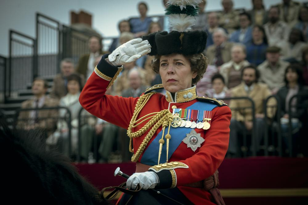 """This image released by Netflix shows Olivia Colman as Queen Elizabeth II in a scene from """"The Crown."""" Colman was nominated for an Emmy Award for outstanding leading actress in a drama series. (Liam Daniel/Netflix via AP)"""