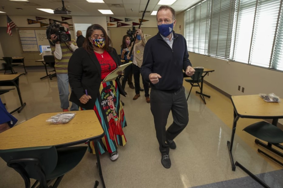 L.A. teachers union President Cecily Myart-Cruz reviews campus-safety measures at Panorama High with then-Supt. Austin Beutner in March. Safety measures were key to the labor pact announced Wednesday by Myart-Cruz and the school district. (Irfan Khan / Los Angeles Times)