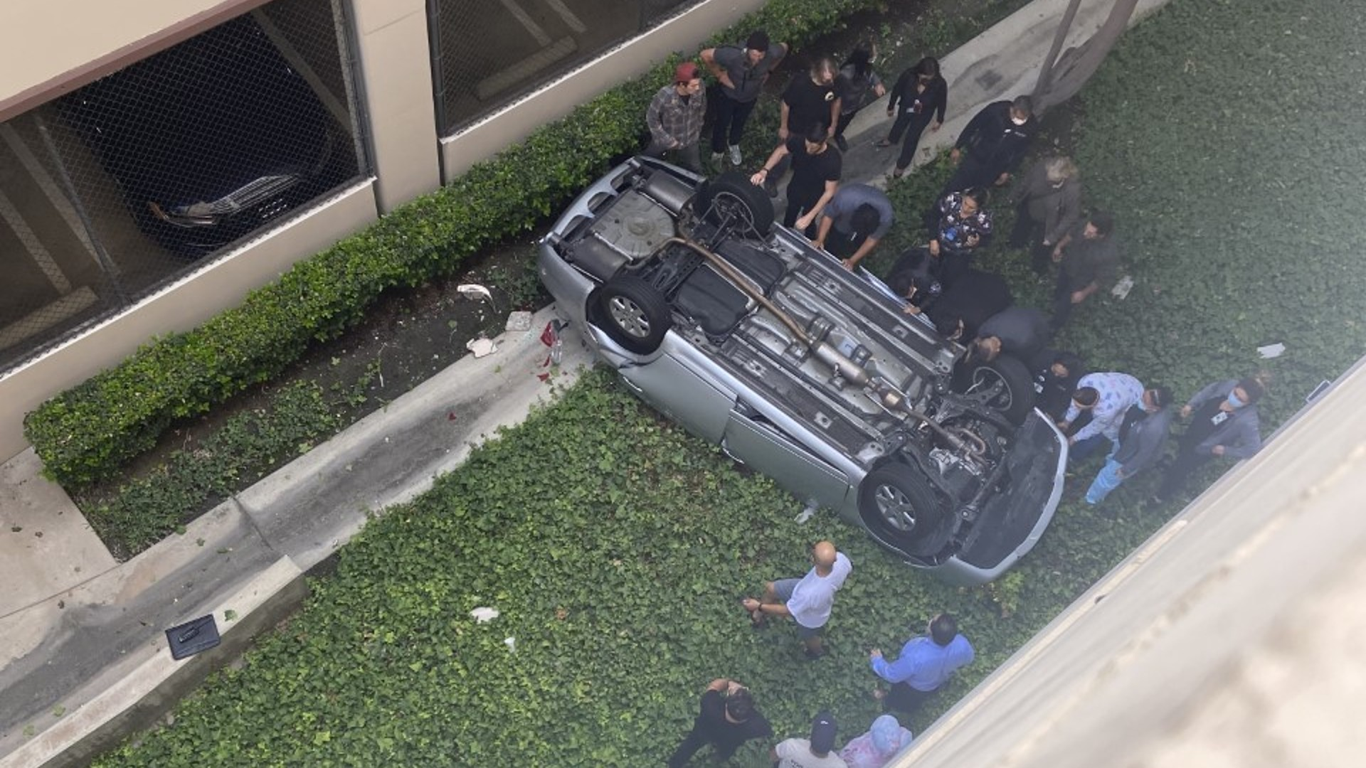A photo submitted by a KTLA viewer showed more than a dozen people surrounding the car before the citizens were able to turn it back over.