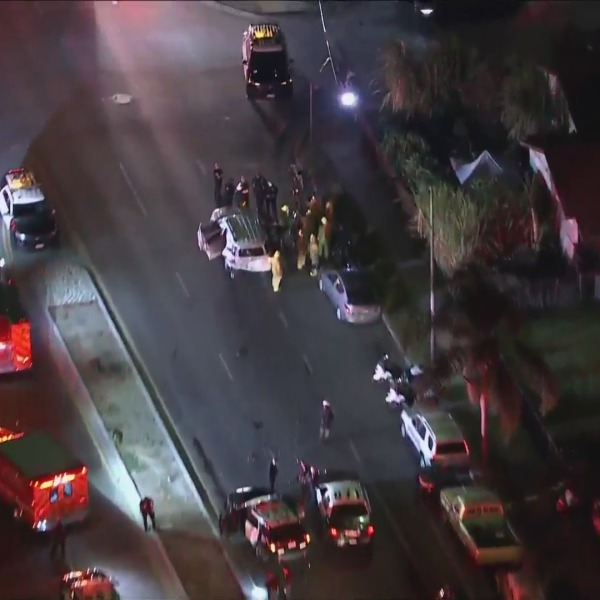 Authorities respond to the scene of a crash where eight people were hurt in South Los Angeles on Sept. 24, 2021. (KTLA)