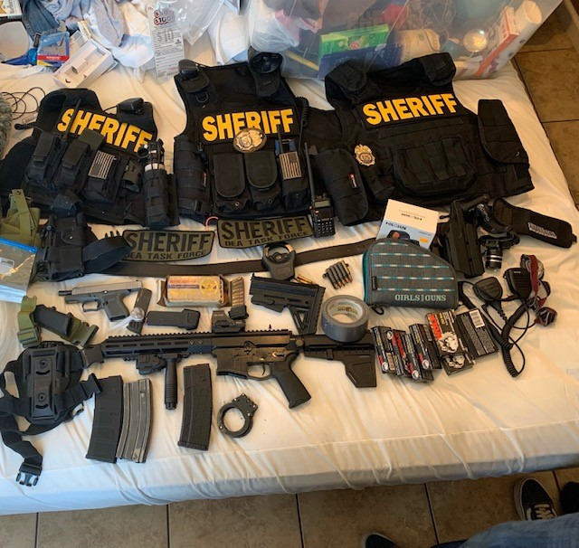 Items discovered during a search of a Hesperia motel room are shown in a photo released by the San Bernardino County Sheriff's Department on Sept. 16, 2021.