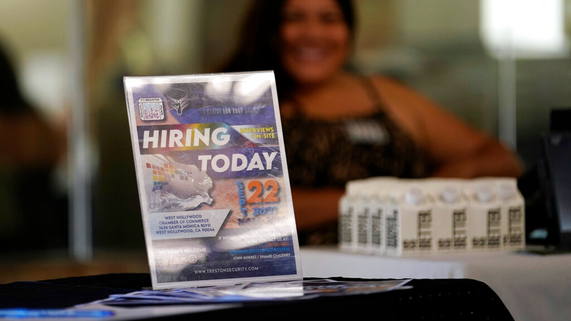 A hiring sign is placed at a booth for prospective employers during a job fair Wednesday, Sept. 22, 2021, in the West Hollywood section of Los Angeles. (AP Photo/Marcio Jose Sanchez)