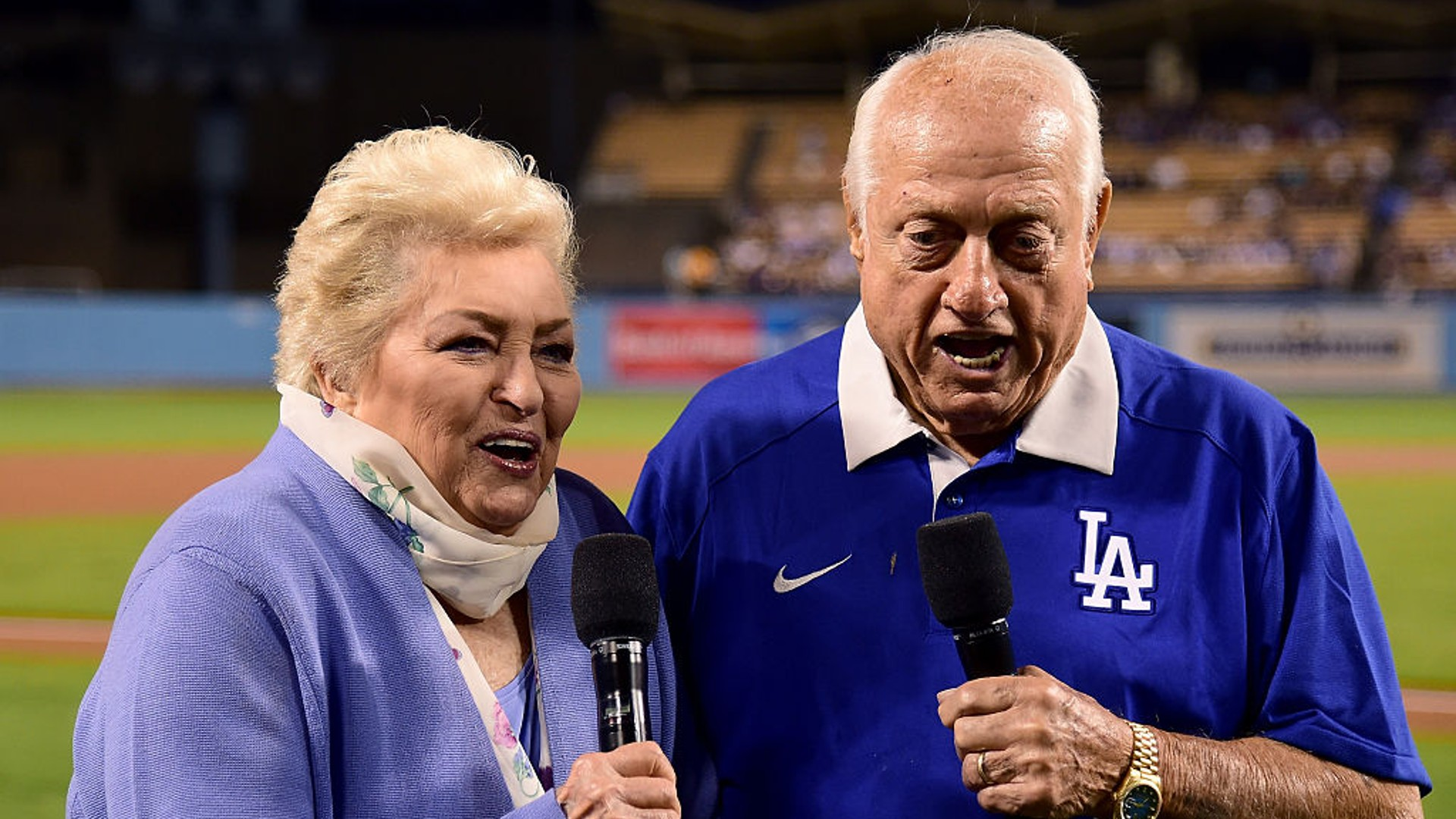 """Tommy and Jo Lasorda make the """"play ball"""" announcement on Tommy's 89th birthday, before the game between the Los Angeles Dodgers and the Colorado Rockies at Dodger Stadium on September 22, 2016 in Los Angeles, California. (Photo by Harry How/Getty Images)"""
